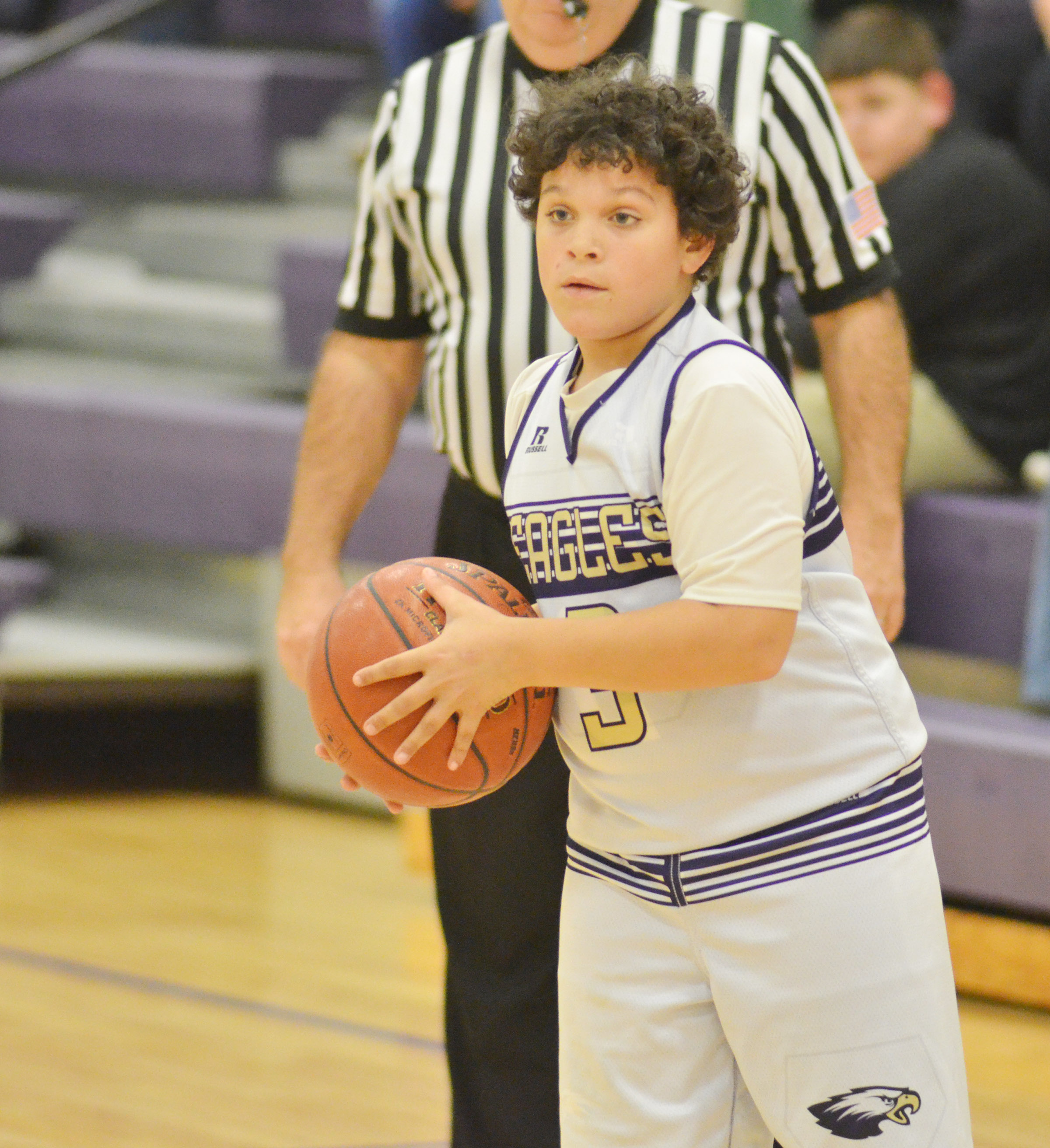 CMS seventh-grader Kaydon Taylor looks to pass.