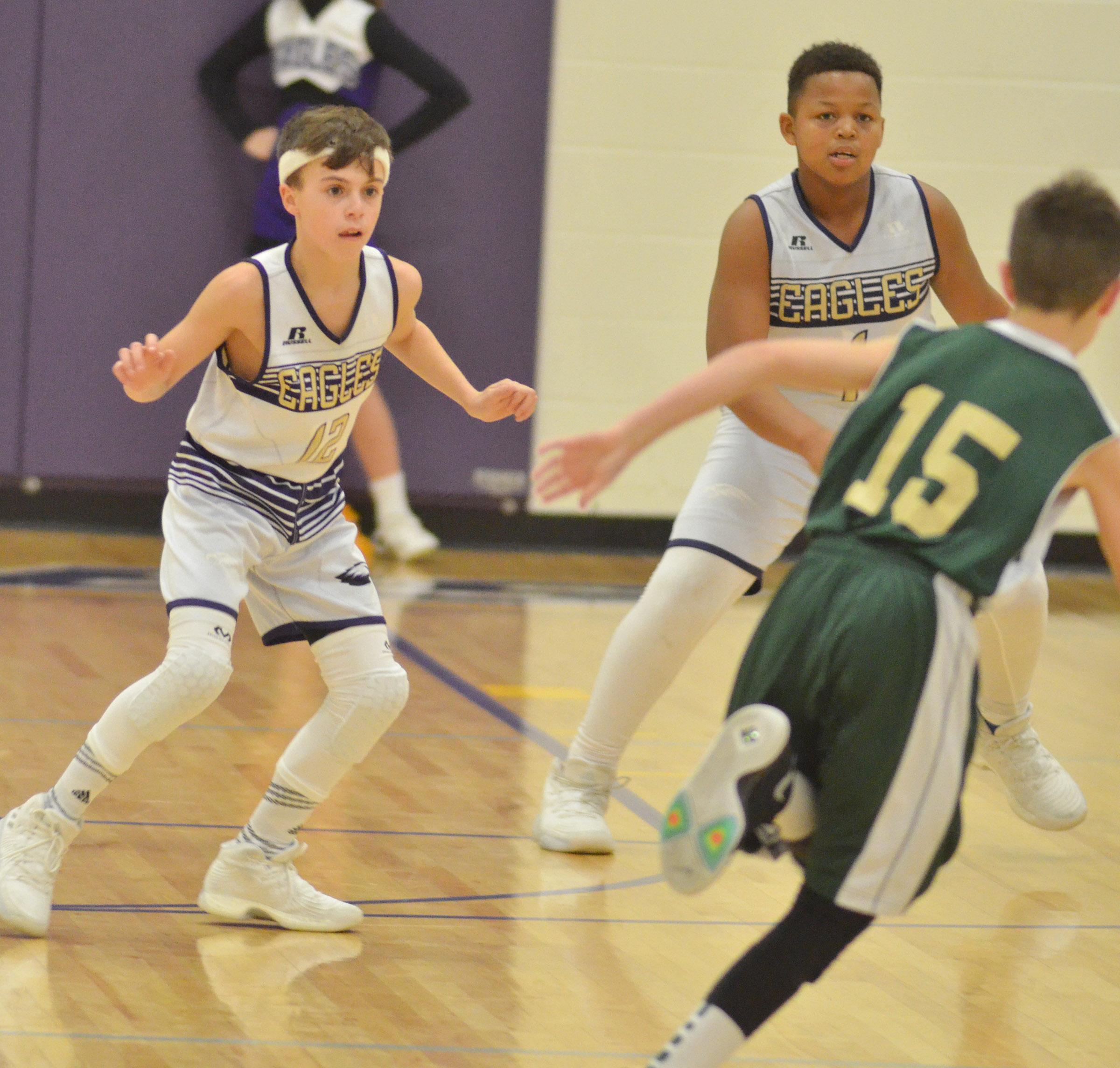 CMS seventh-graders Chase Hord, at left, and Keondre Weathers play defense.