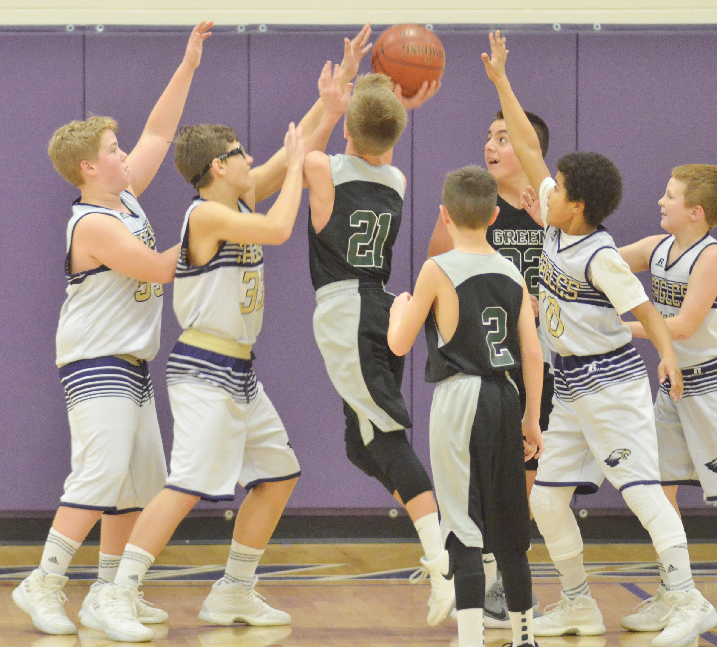 "From left, CMS sixth-grader Ryan Grubbs, Campbellsville Elementary School fifth-grader Dalton Morris and sixth-graders Tashaun Hart and Jason ""Junior"" Jeffries try to block a shot."