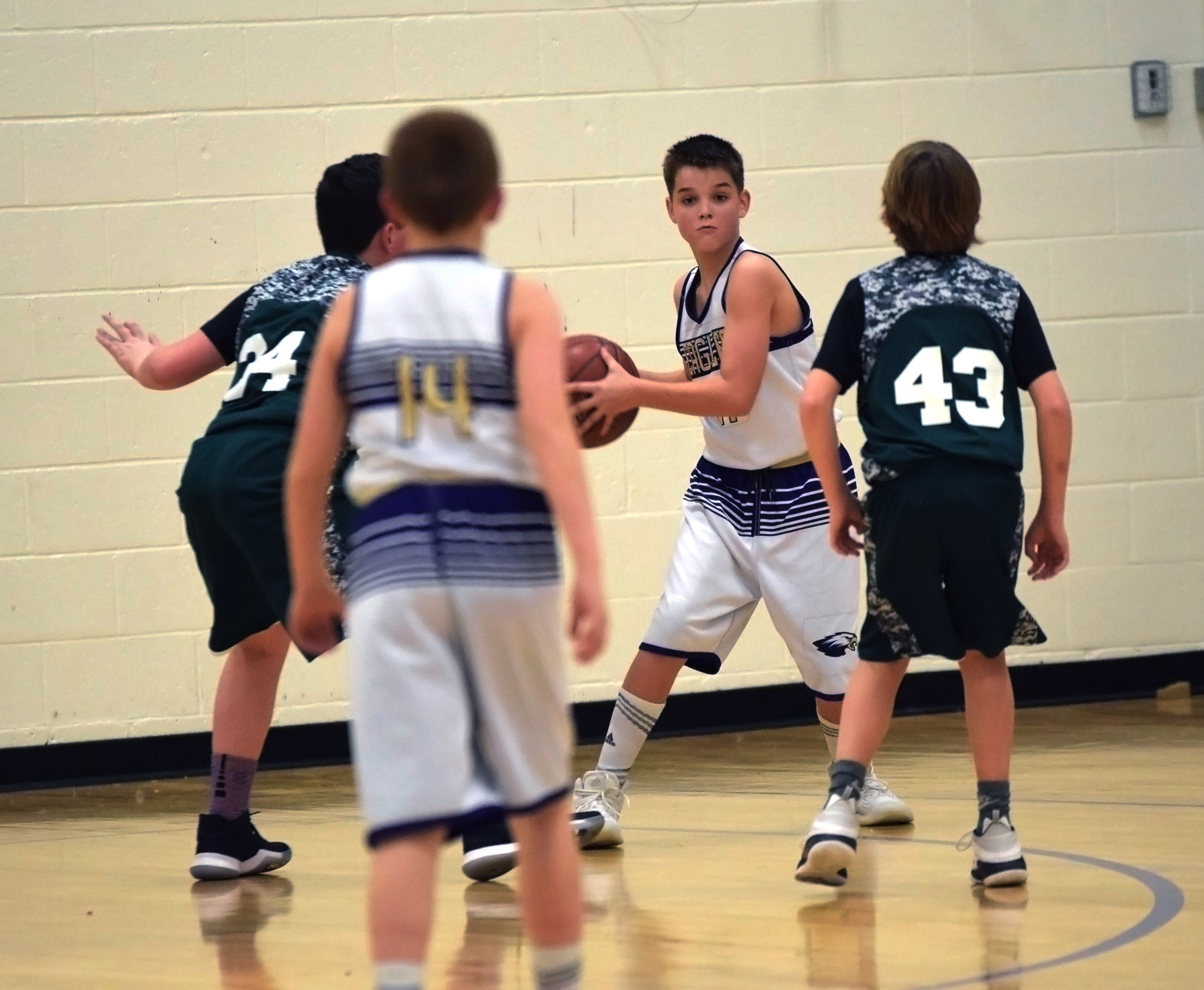 CMS sixth-grader Kaden Bloyd looks for a teammate.