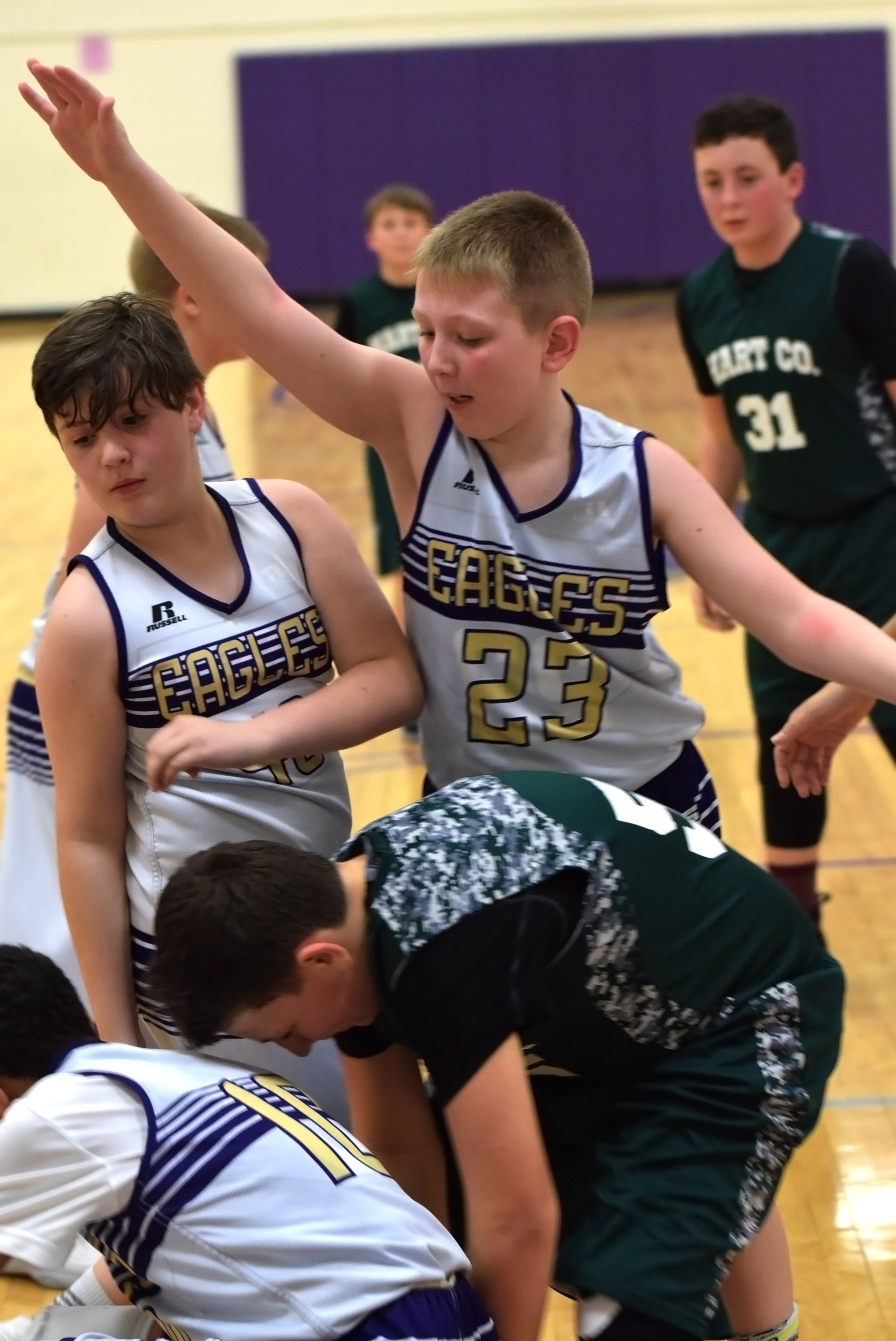 Campbellsville Elementary School fifth-graders Andrew Mardis, at left, and Kaleb Miller play defense.