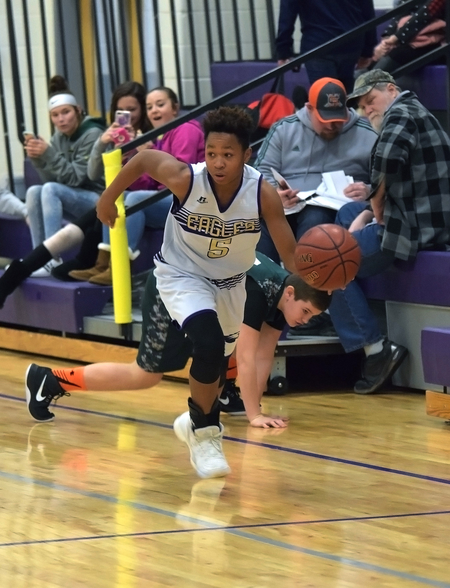 CMS seventh-grader Deondre Weathers dribbles down the court.