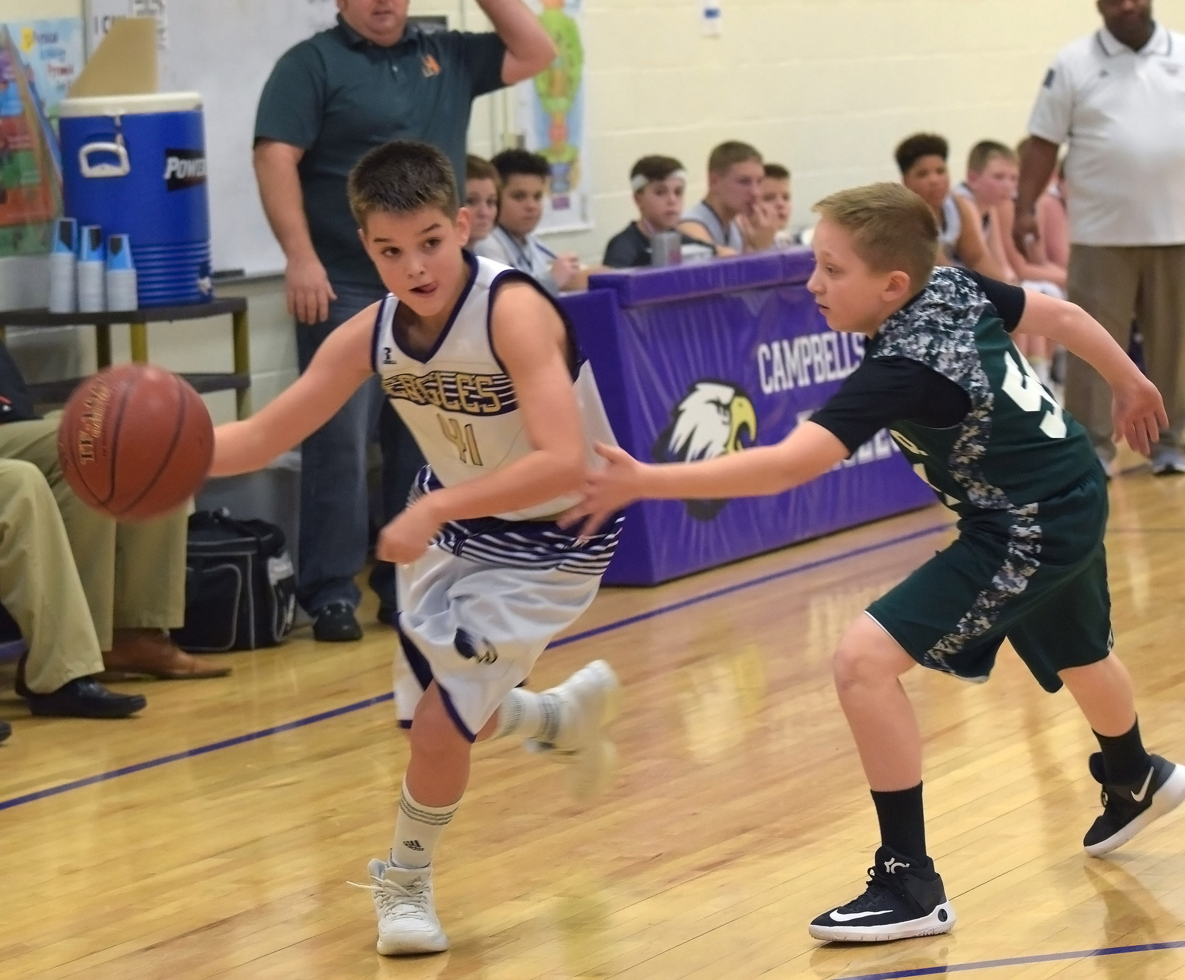 CMS sixth-grader Kaden Bloyd dribbles to the basket.