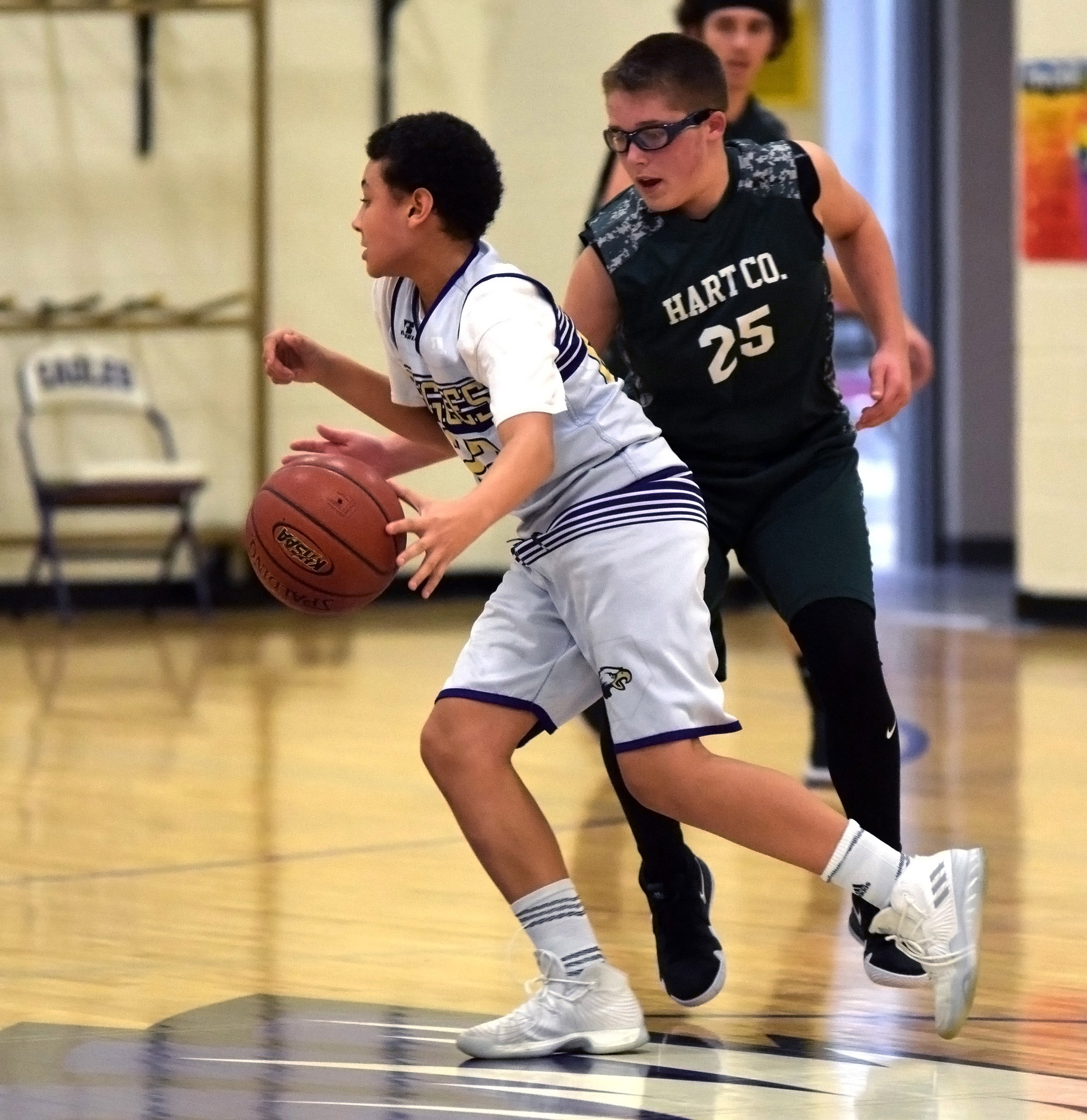 CMS eighth-grader Brice Spaw dribbles around a Hart County defender.
