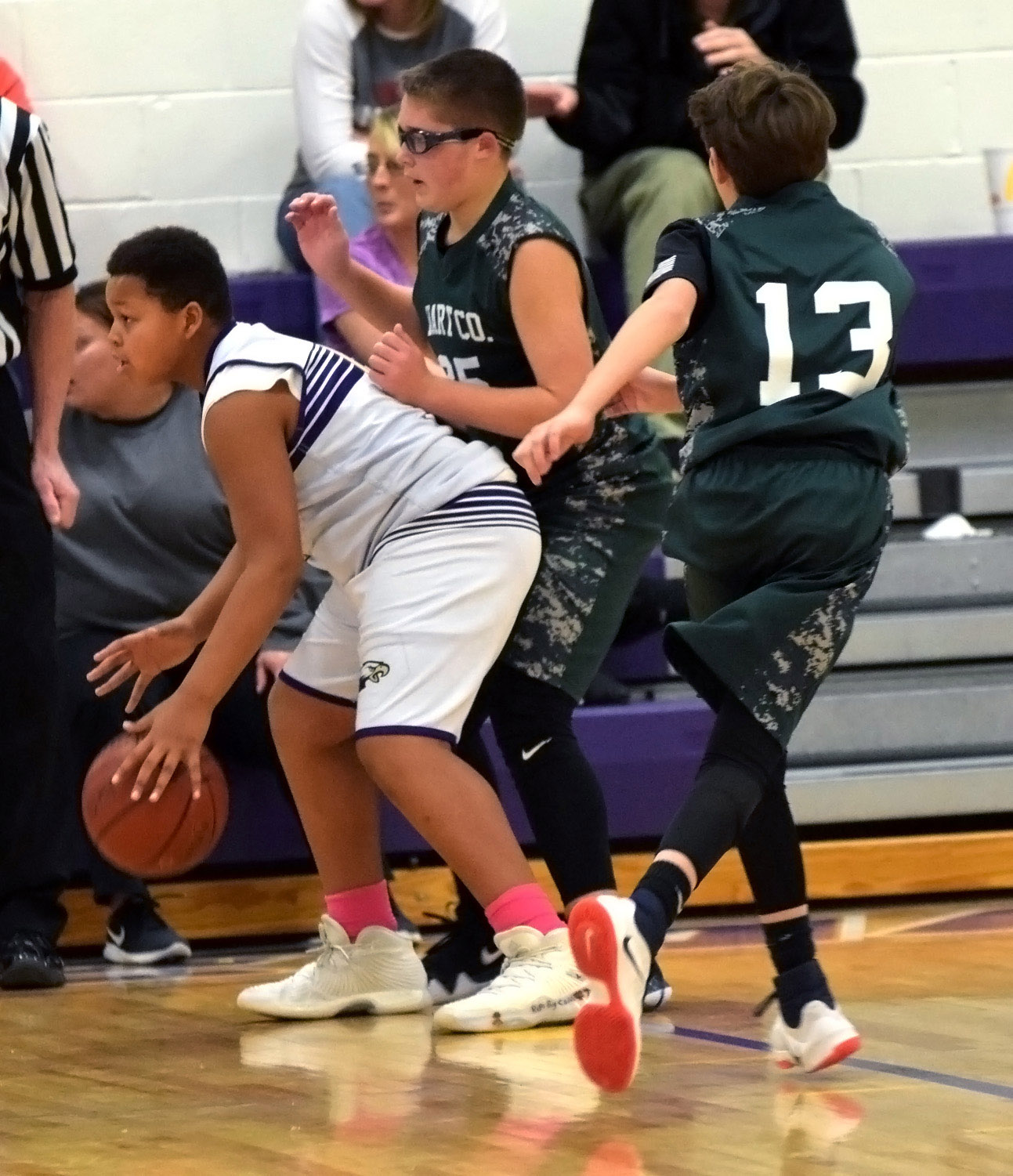 CMS seventh-grader Keondre Weathers dribbles.