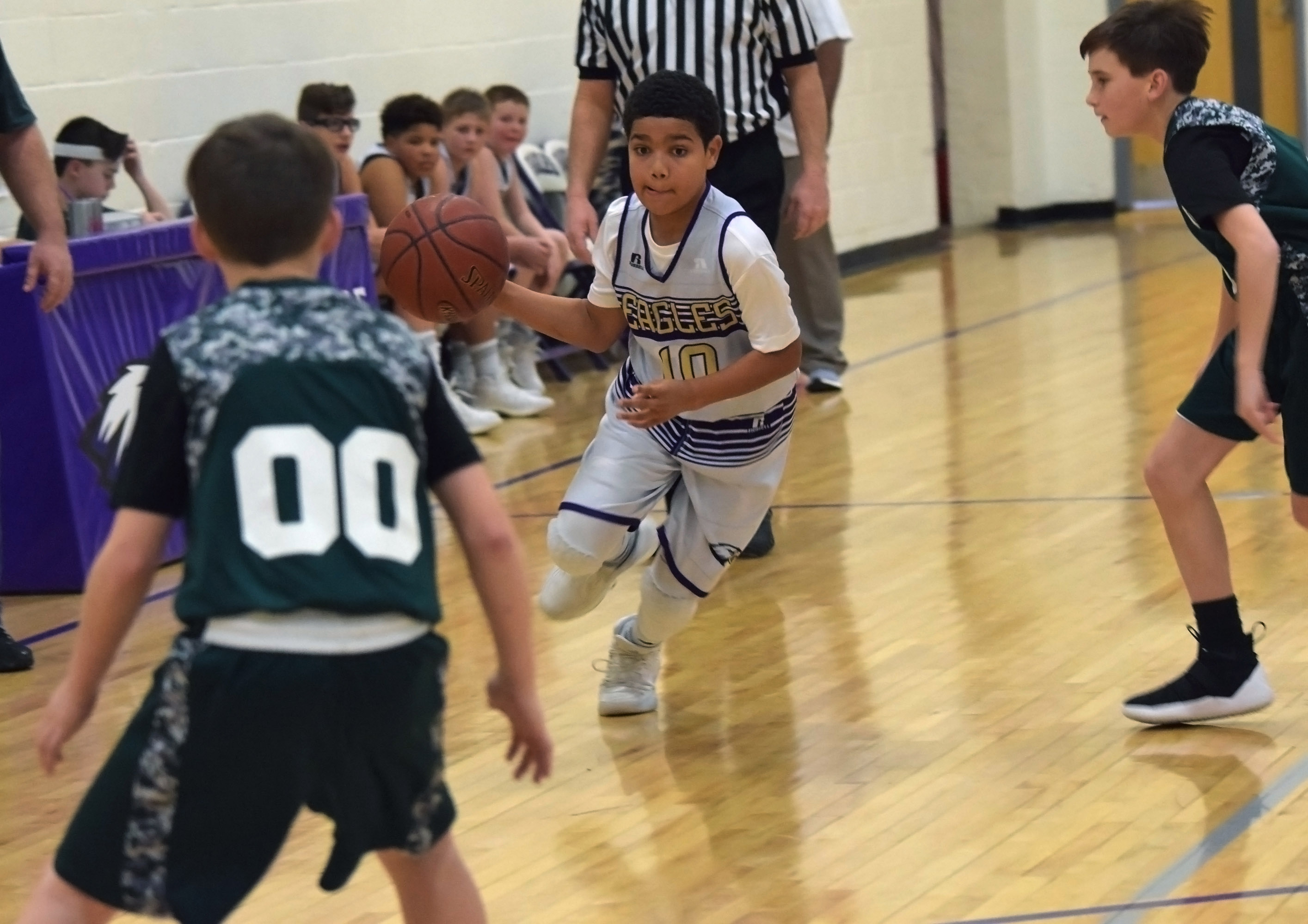 CMS sixth-grader Tashaun Hart drives the ball to the basket.