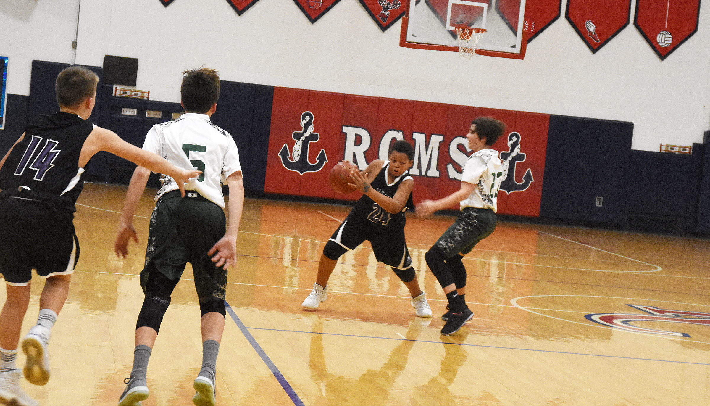 CMS seventh-grader Keondre Weathers passes the ball.
