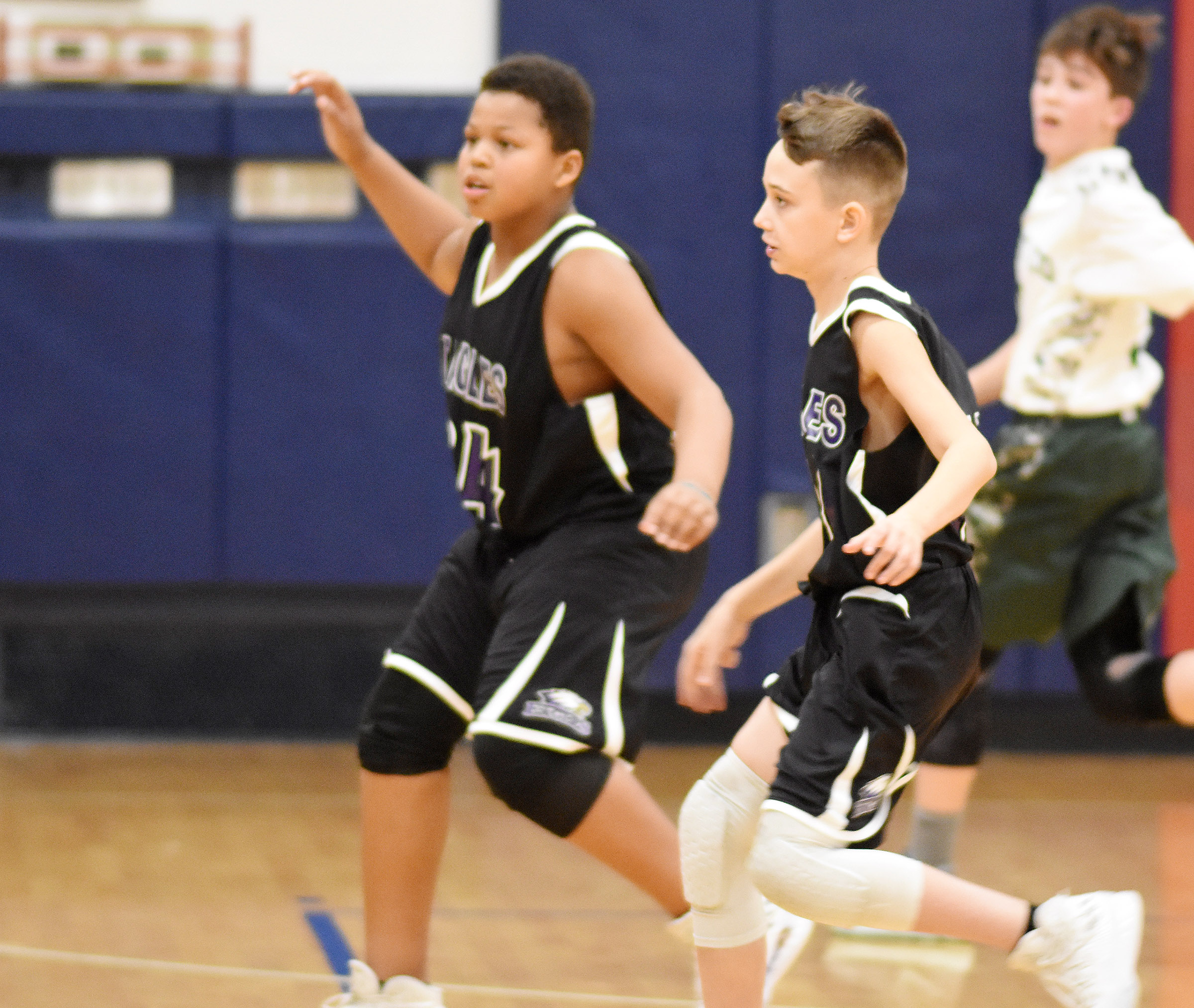 CMS seventh-graders Keondre Weathers, at left, and Camren Vicari play defense.