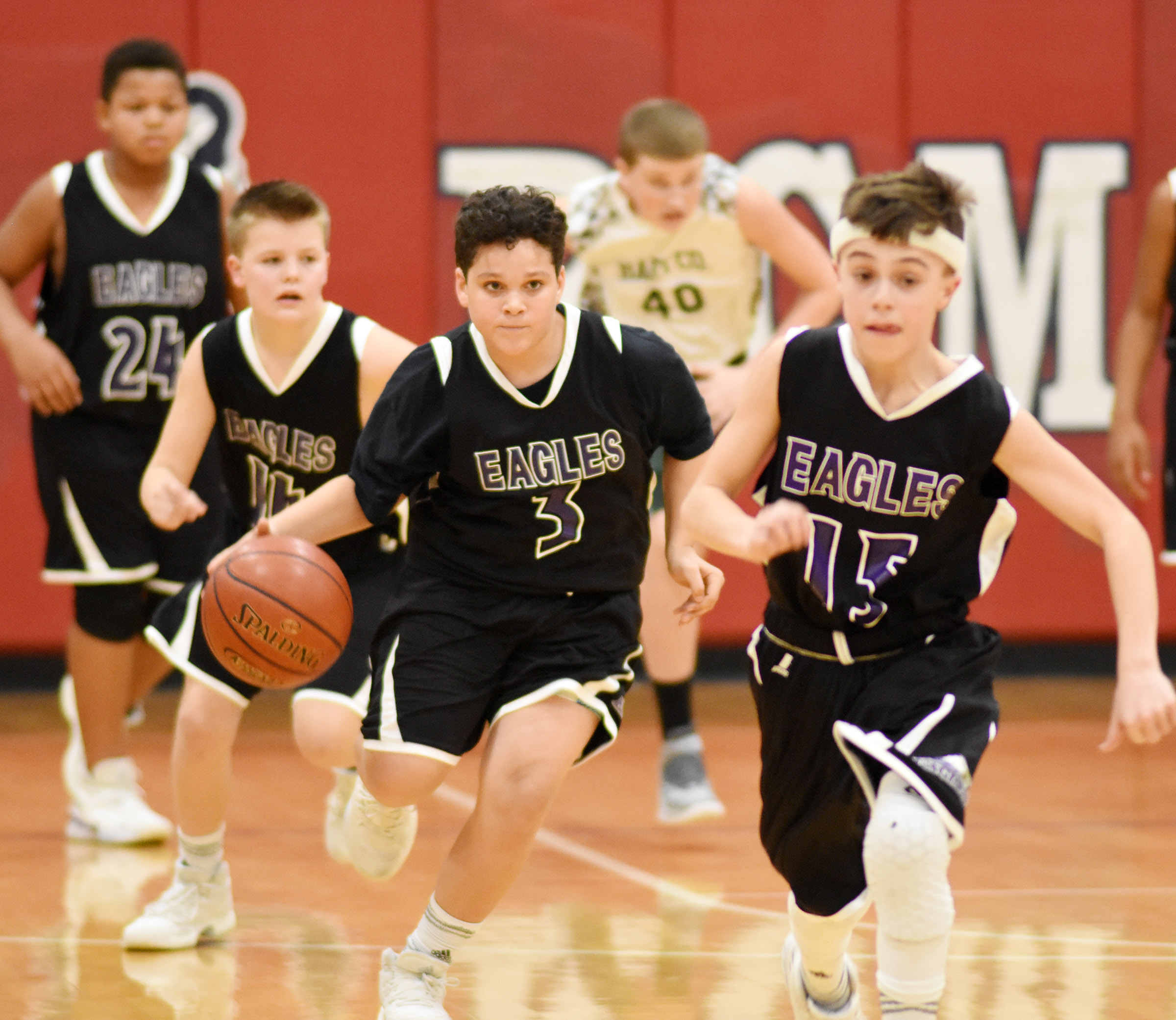 CMS seventh-grader Kaydon Taylor dribbles to the basket.