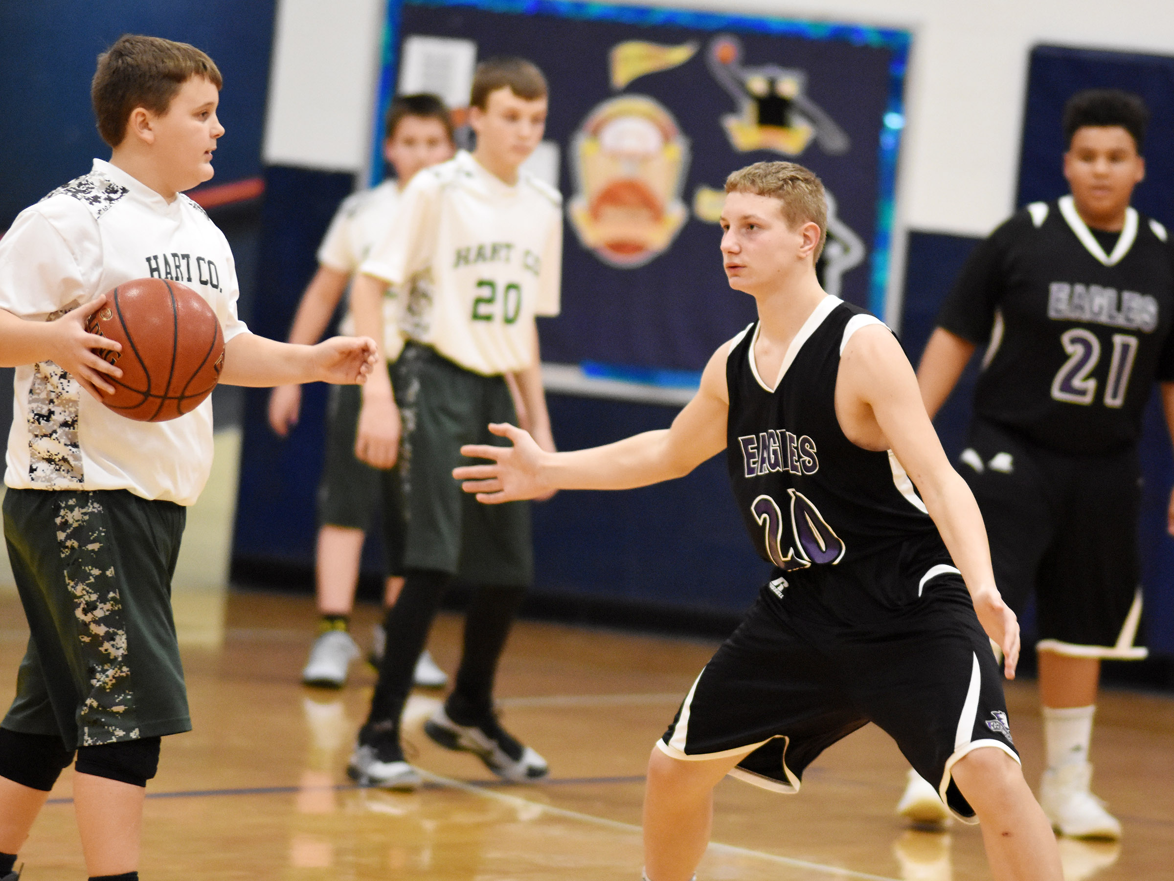 CMS seventh-grader Damon Johnson plays defense.