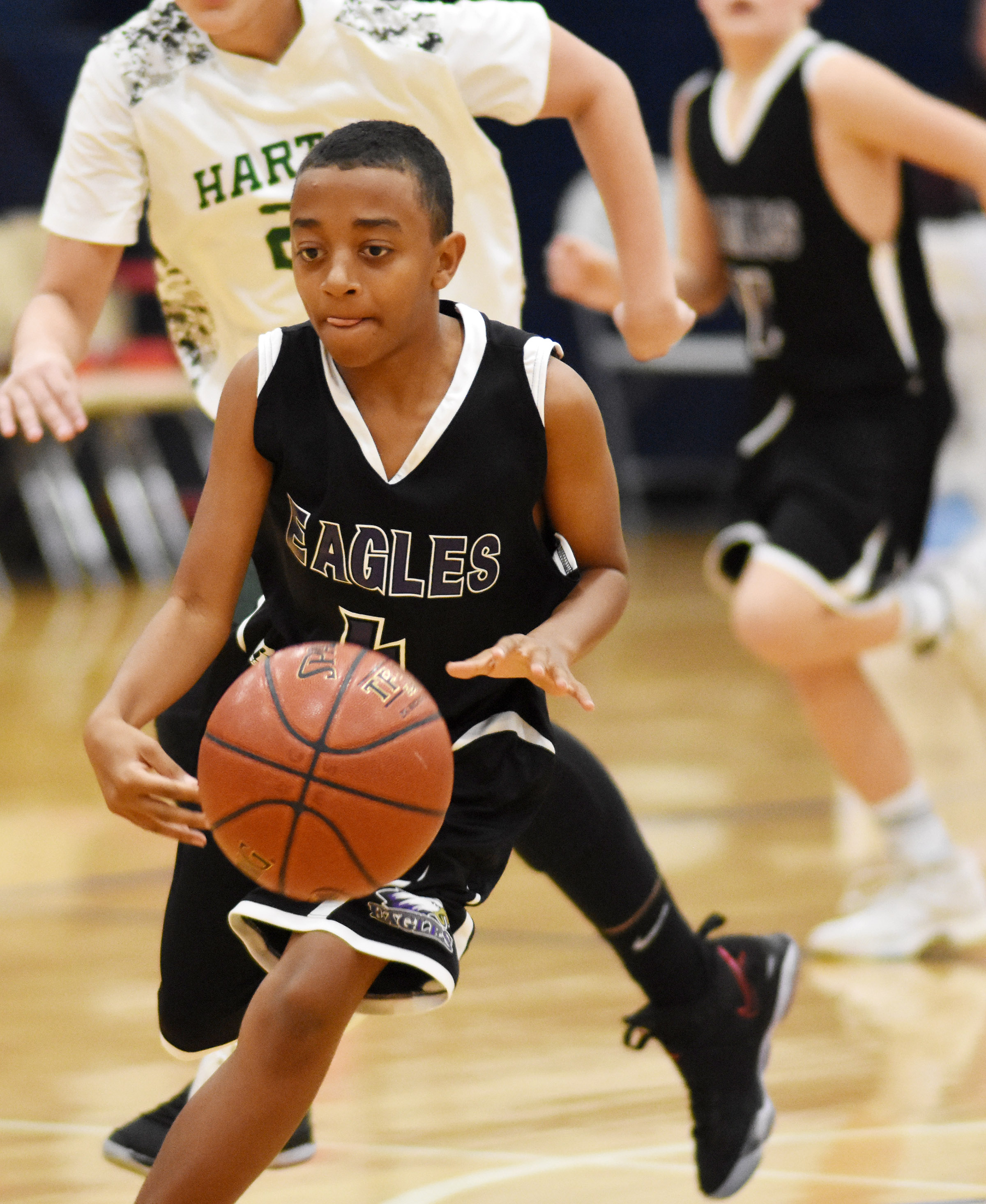 CMS seventh-grader Zamar Owens drives the ball to the basket.
