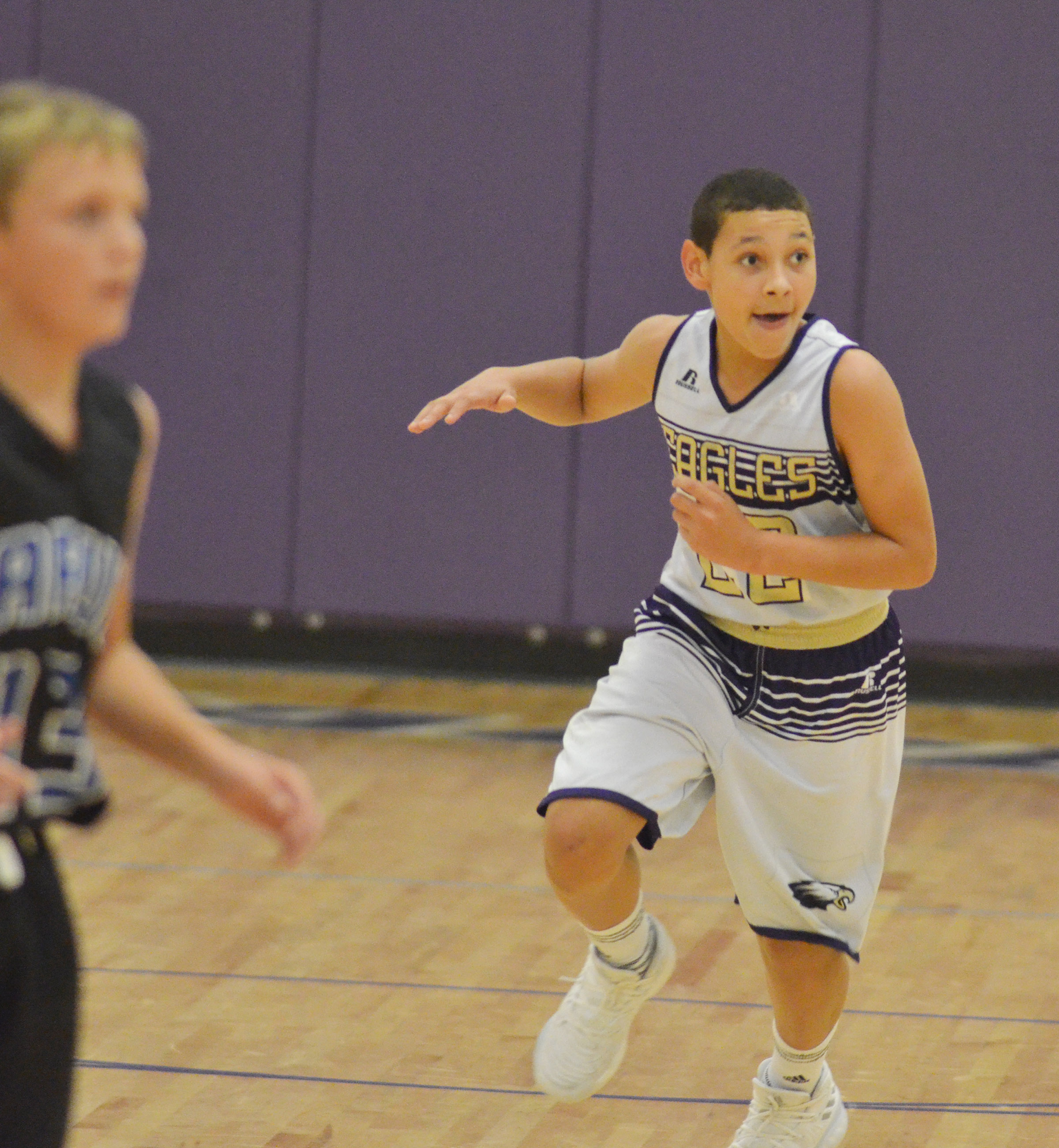 CMS eighth-grader Brice Spaw runs down the court.