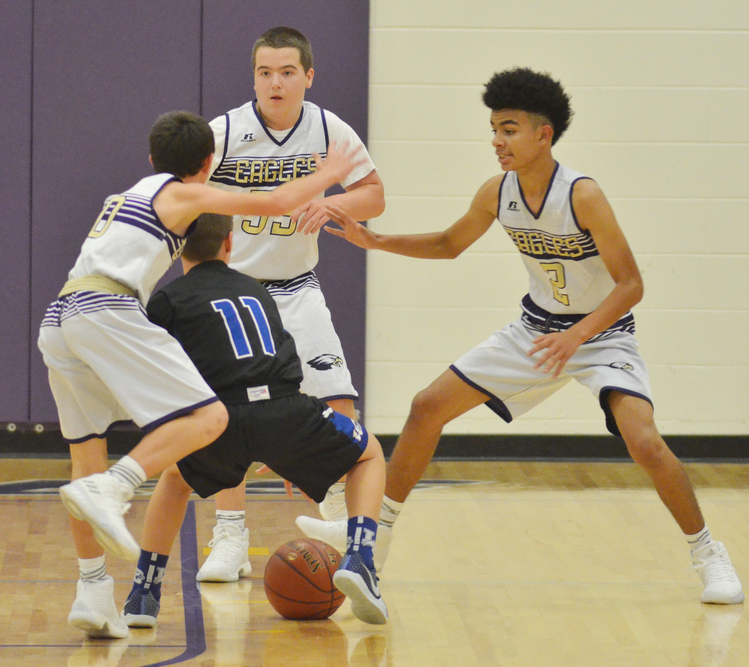 From left, CMS eighth-graders Dakota Harris, Jack Sabo and Adrien Smith play defense.