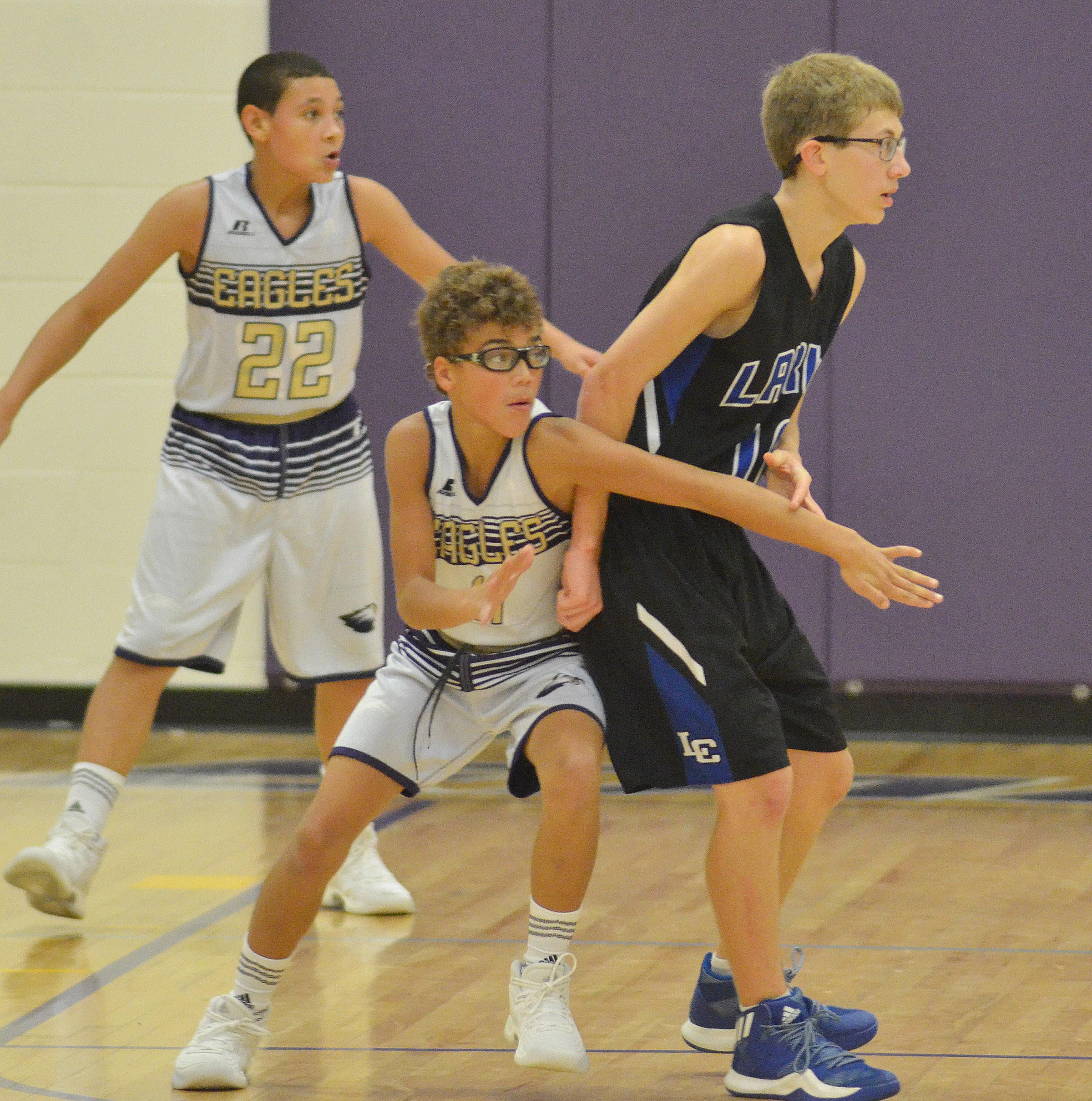 CMS eighth-graders Brice Spaw, at left, and Logan Phillips play defense.