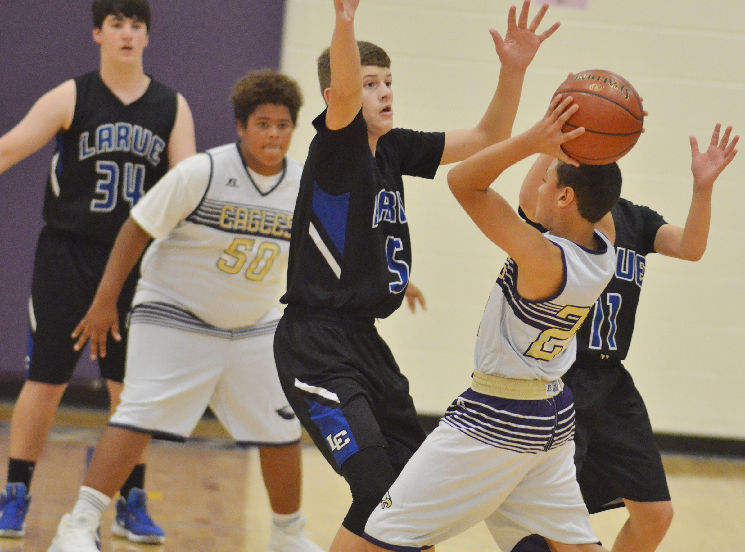 CMS eighth-grader Brice Spaw looks to pass.
