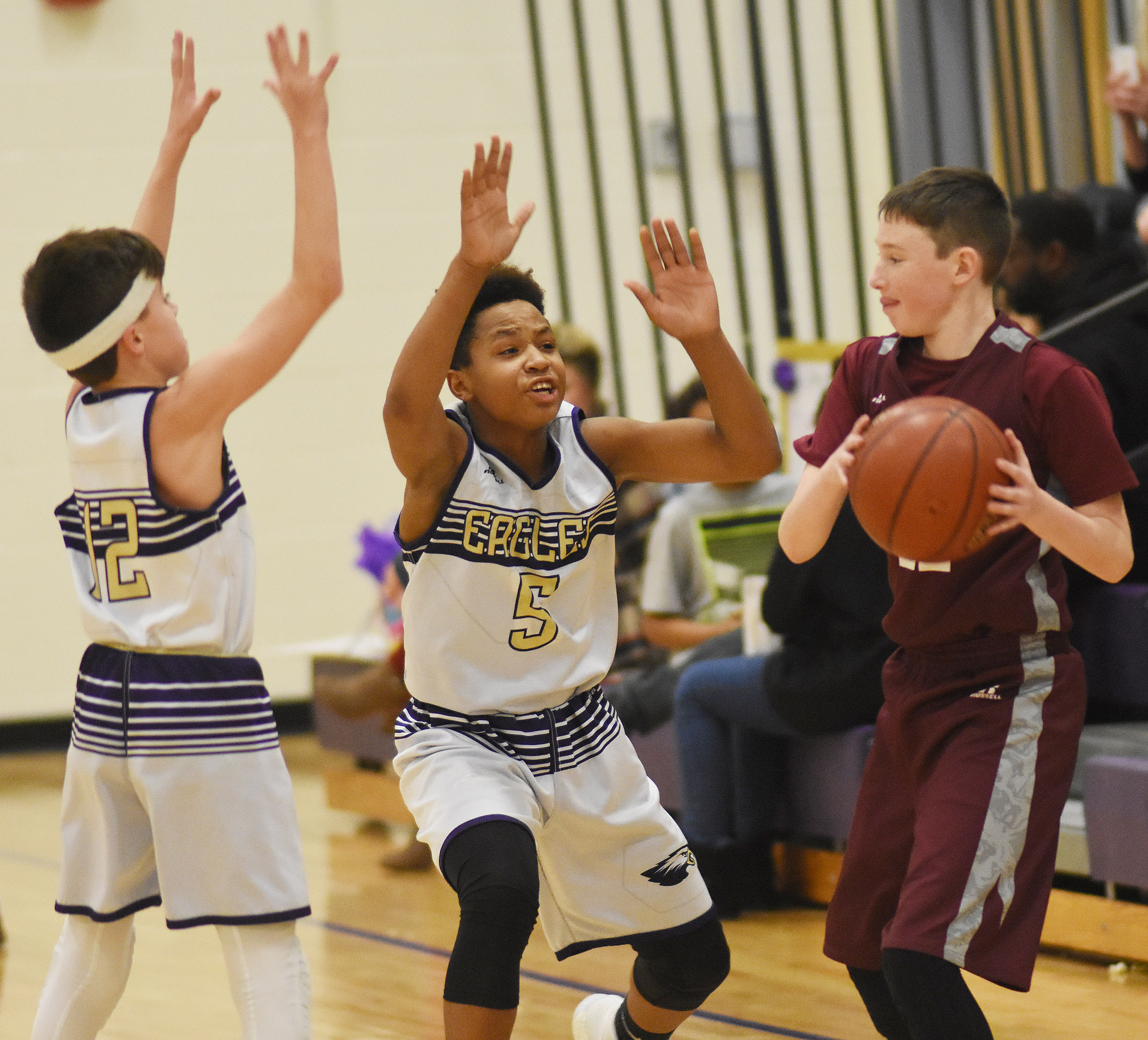 CMS seventh-graders Chase Hord, at left, and Deondre Weathers play defense.