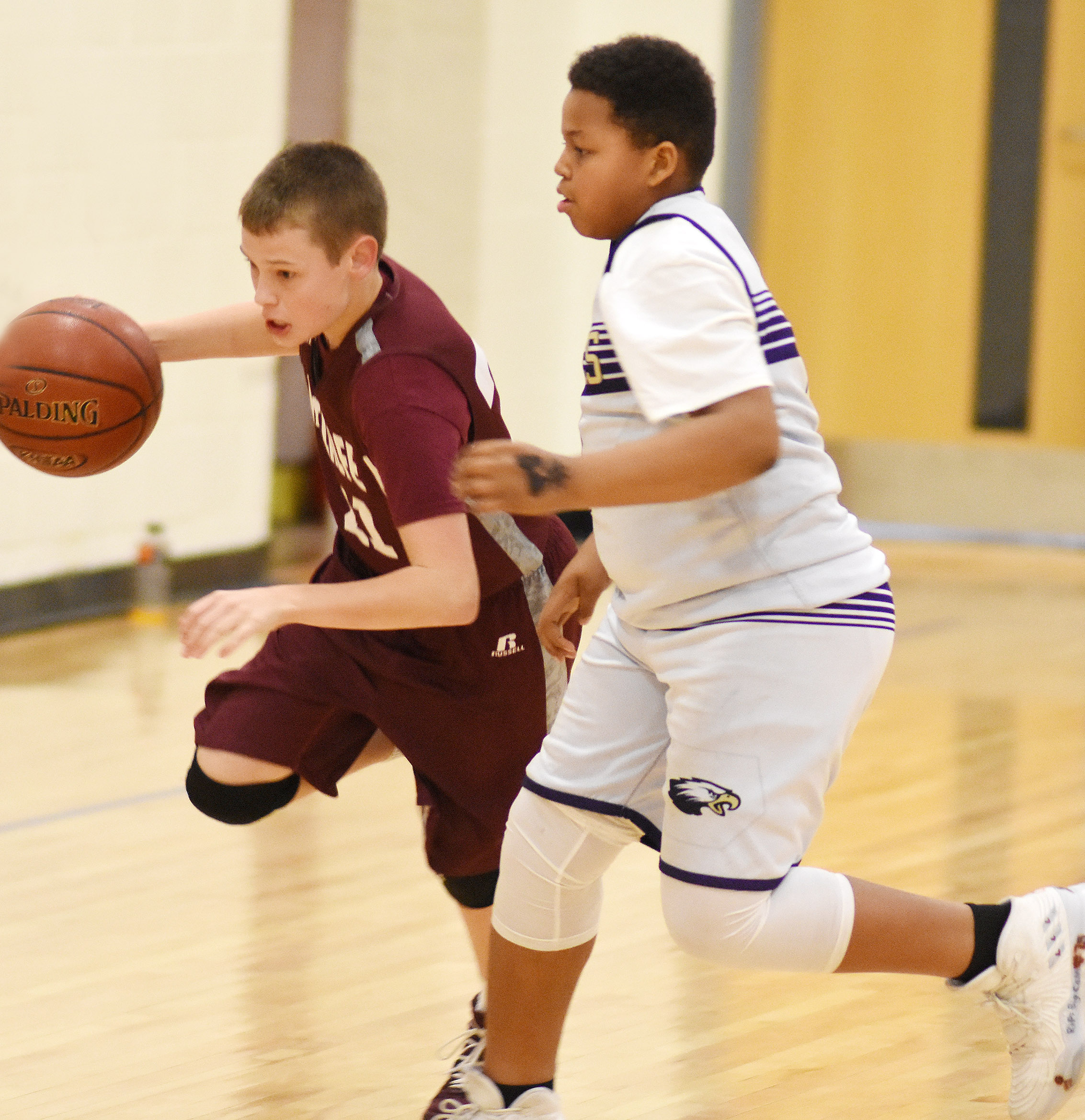 CMS seventh-grader Keondre Weathers plays defense.