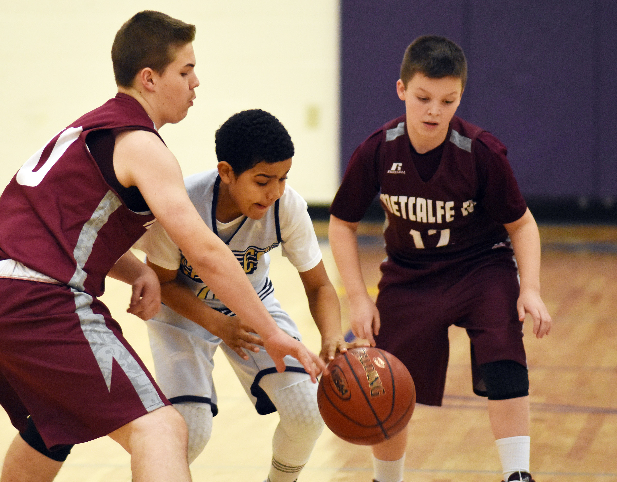 CMS sixth-grader Tashaun Hart fights for the ball.
