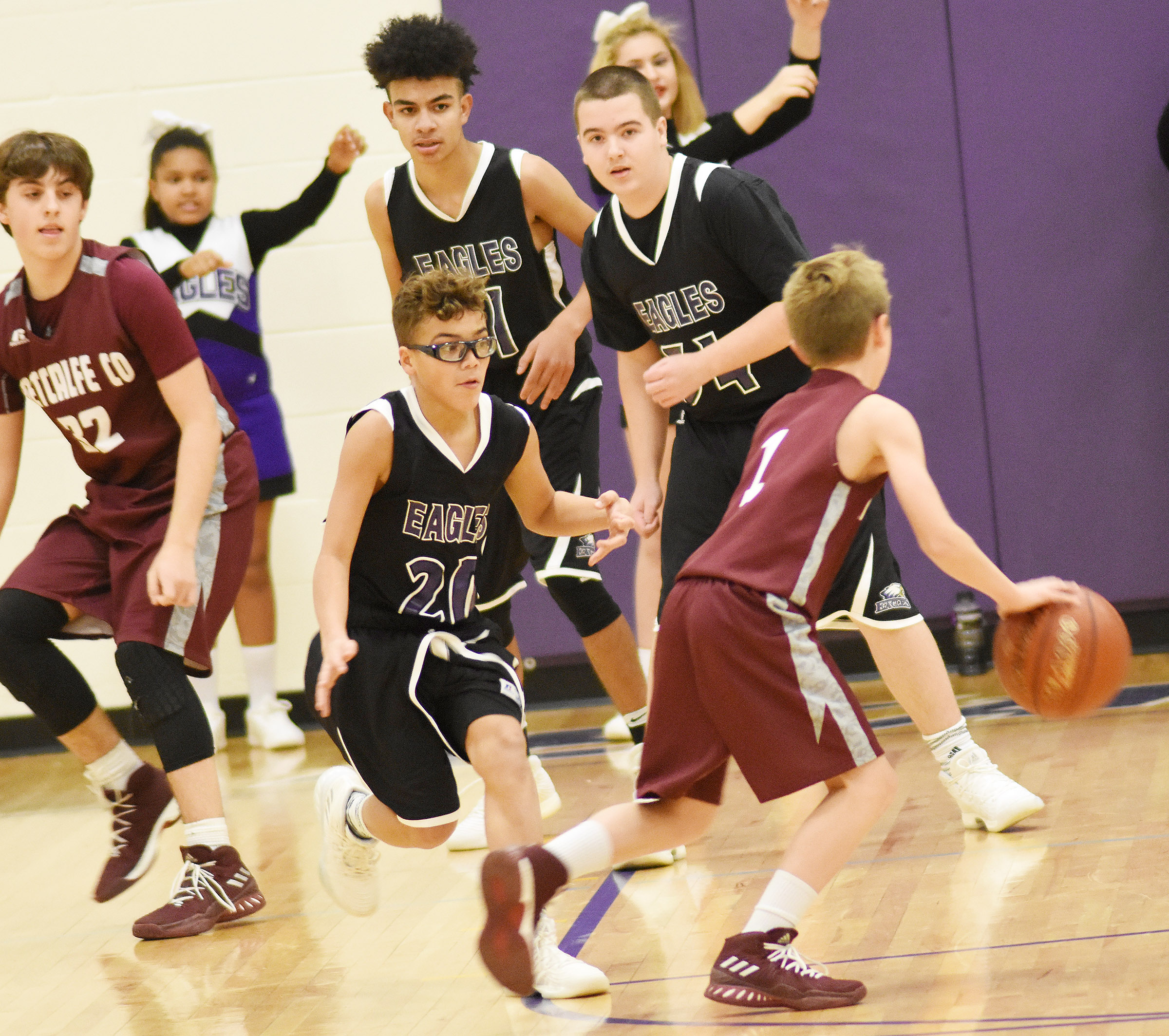 From left, CMS eighth-graders Logan Phillips, Adrien Smith and Jack Sabo play defense.