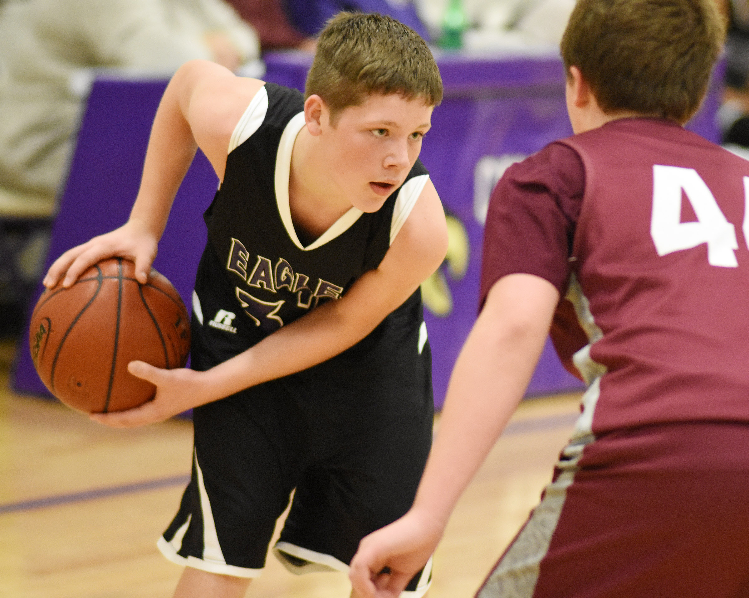 CMS eighth-grader Josh Lucas protects the ball.