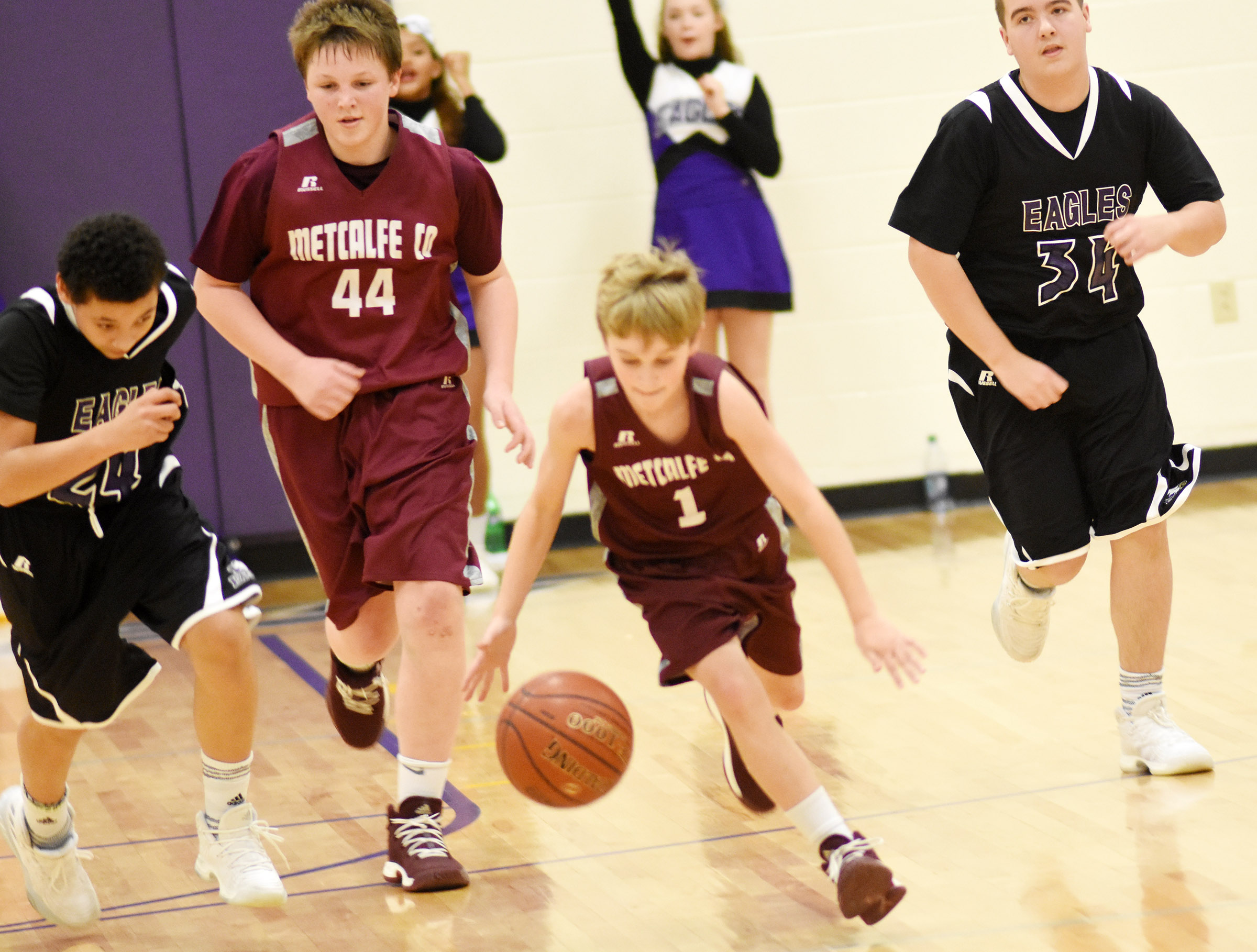CMS eighth-graders Brice Spaw, at left, and Jack Sabo run down the court.