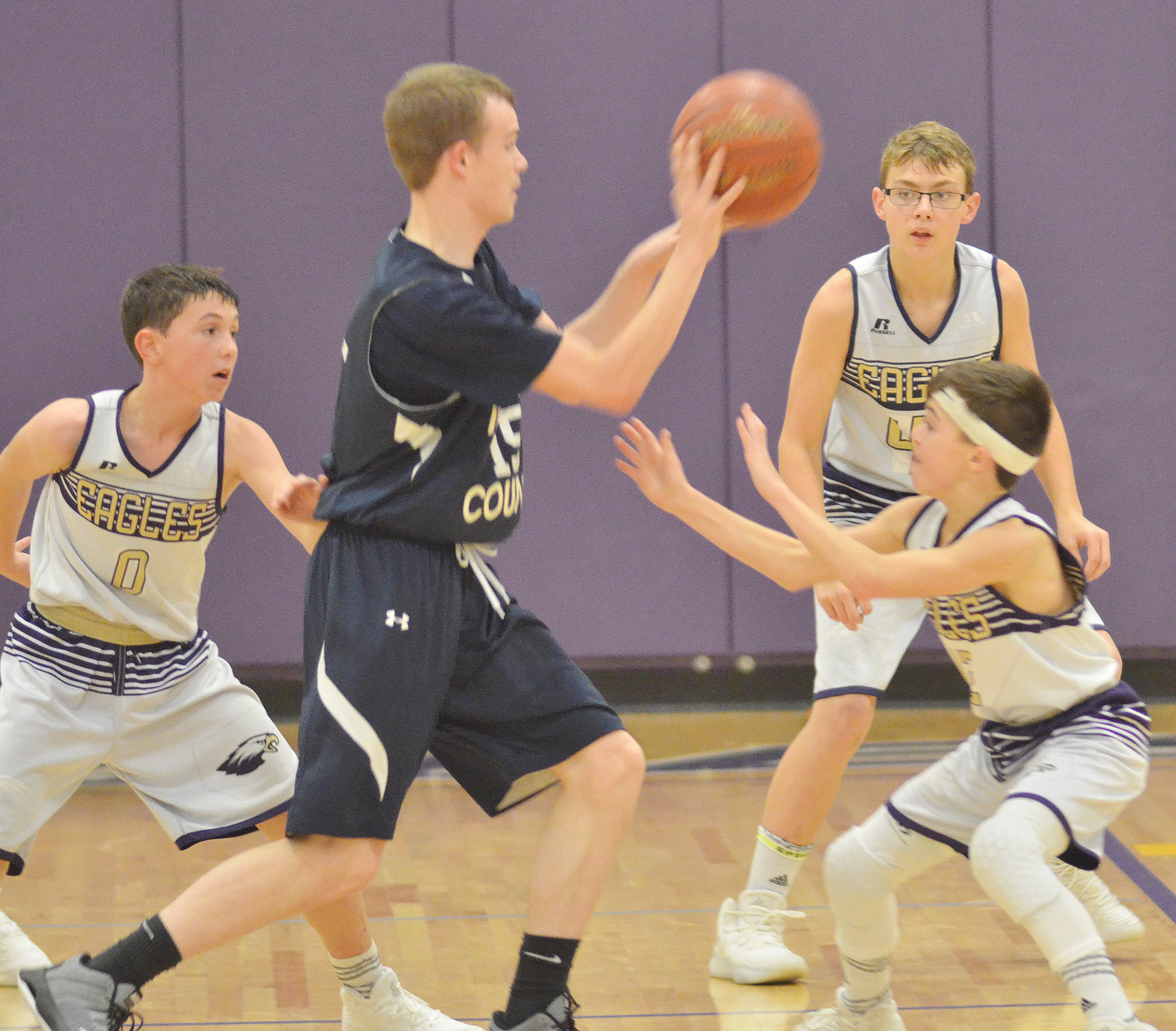From left, CMS eighth-graders Brice Spaw and Jarred and seventh-grader Chase Hord play defense.