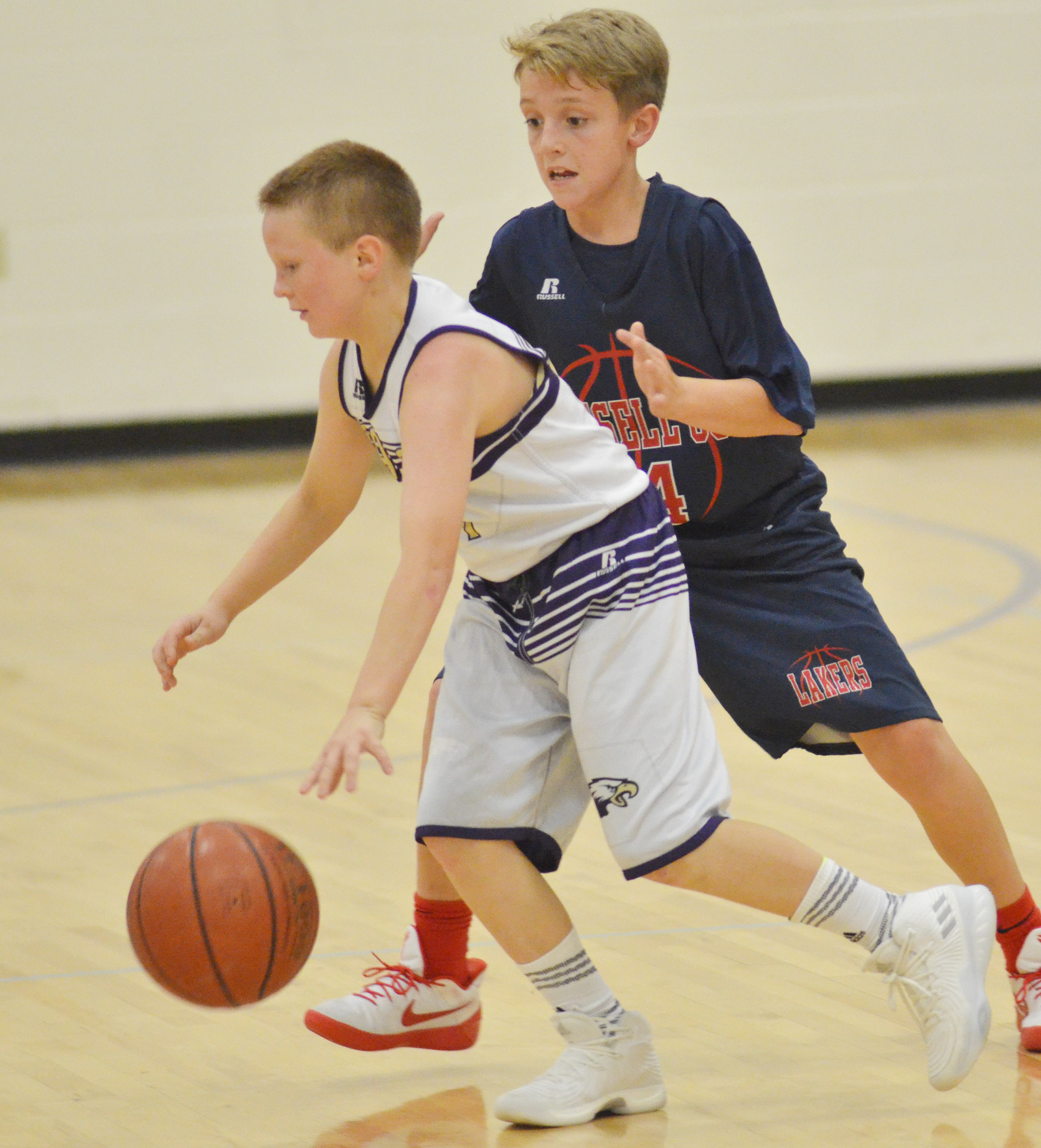 "CMS sixth-grader Jason ""Junior"" Jeffries protects the ball."