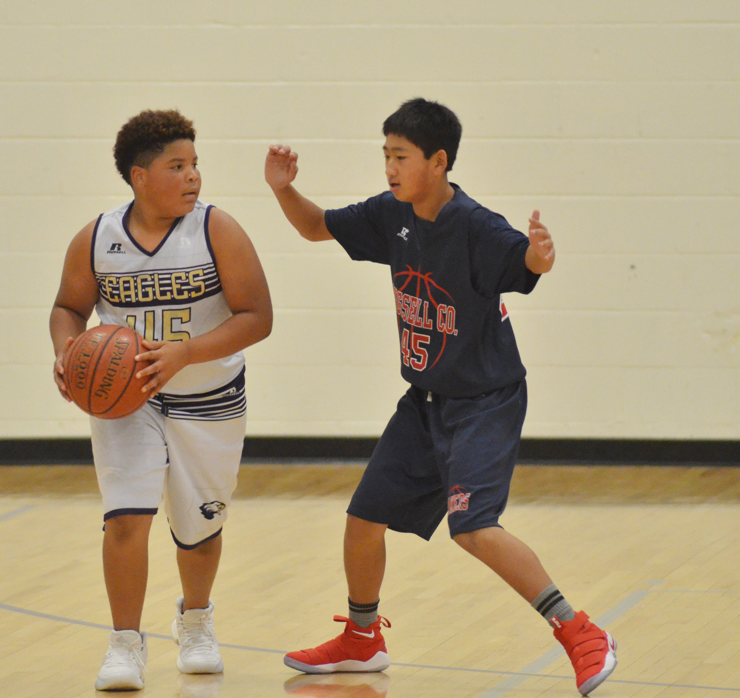 CMS sixth-grader Devin Kinser looks to pass.