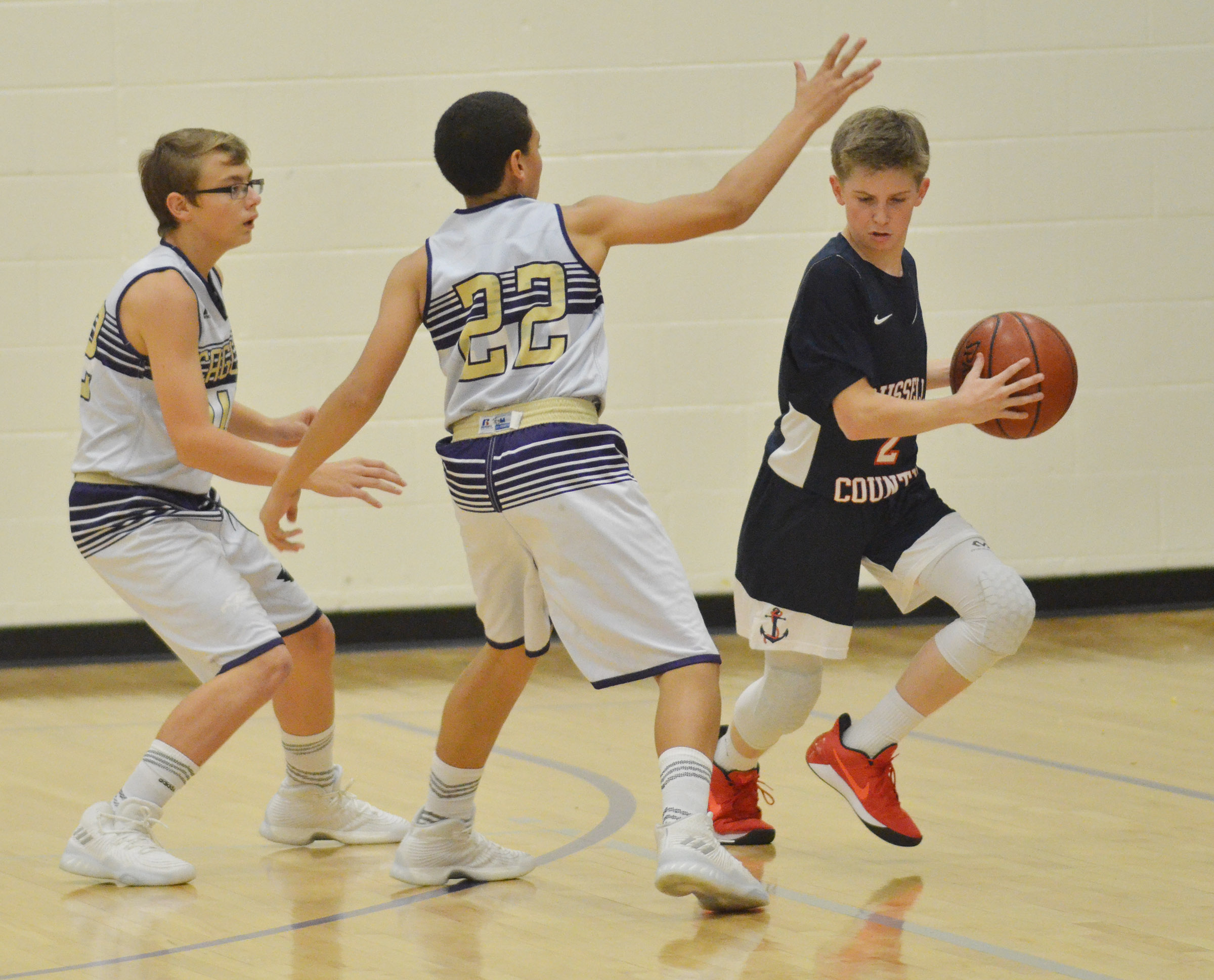 CMS eighth-graders Jarred Mays, at left, and Brice Spaw play defense.
