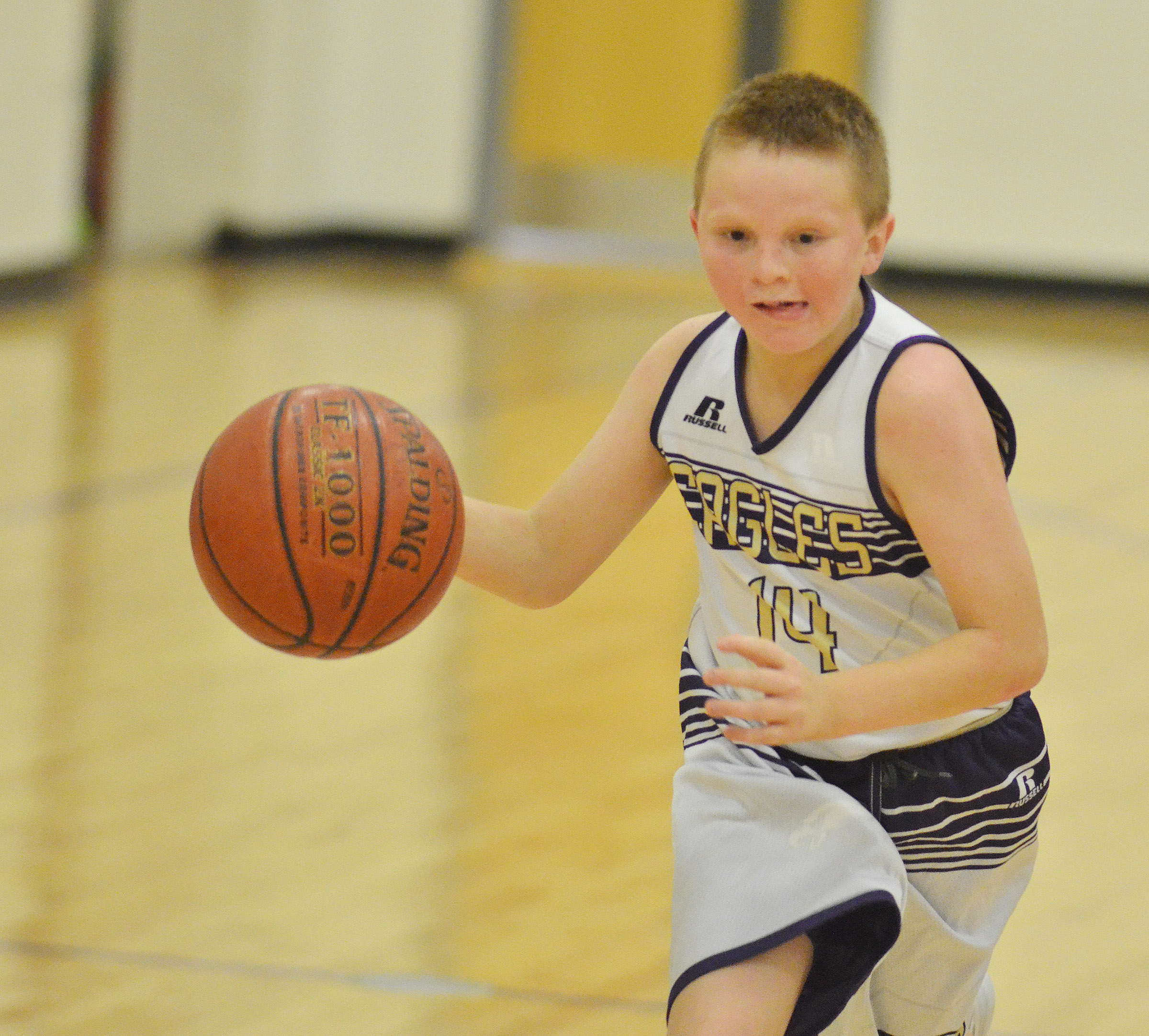 "CMS sixth-grader Jason ""Junior"" Jeffries dribbles to the hoop."