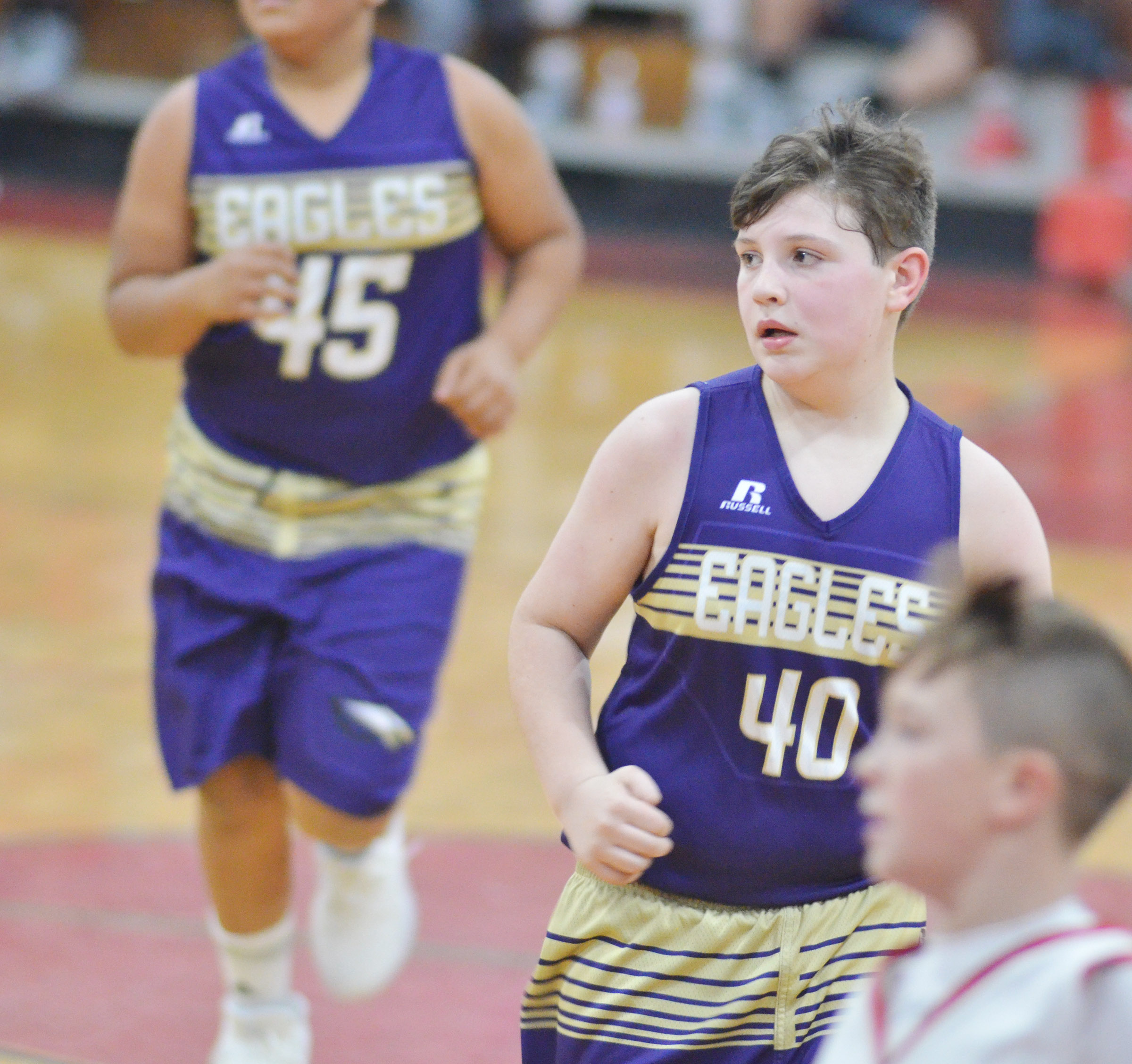 Campbellsville Elementary School fifth-grader Andrew Mardis runs down the court.