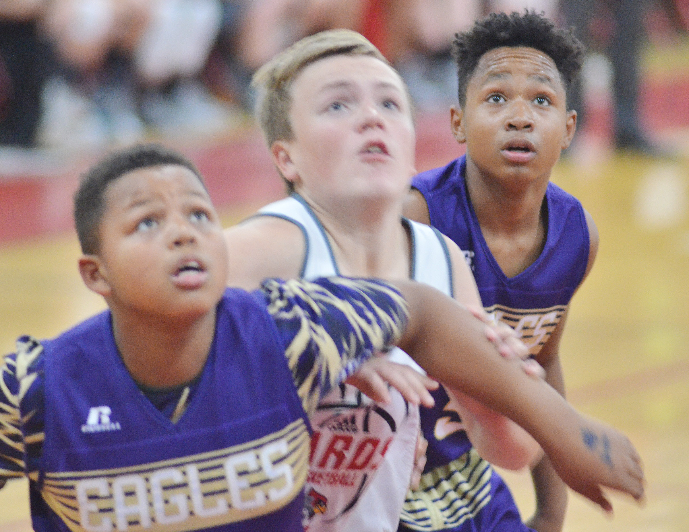 CMS seventh-grader Deondre Weathers, at right, looks for a rebound. At left is his twin brother Deondre Weathers.