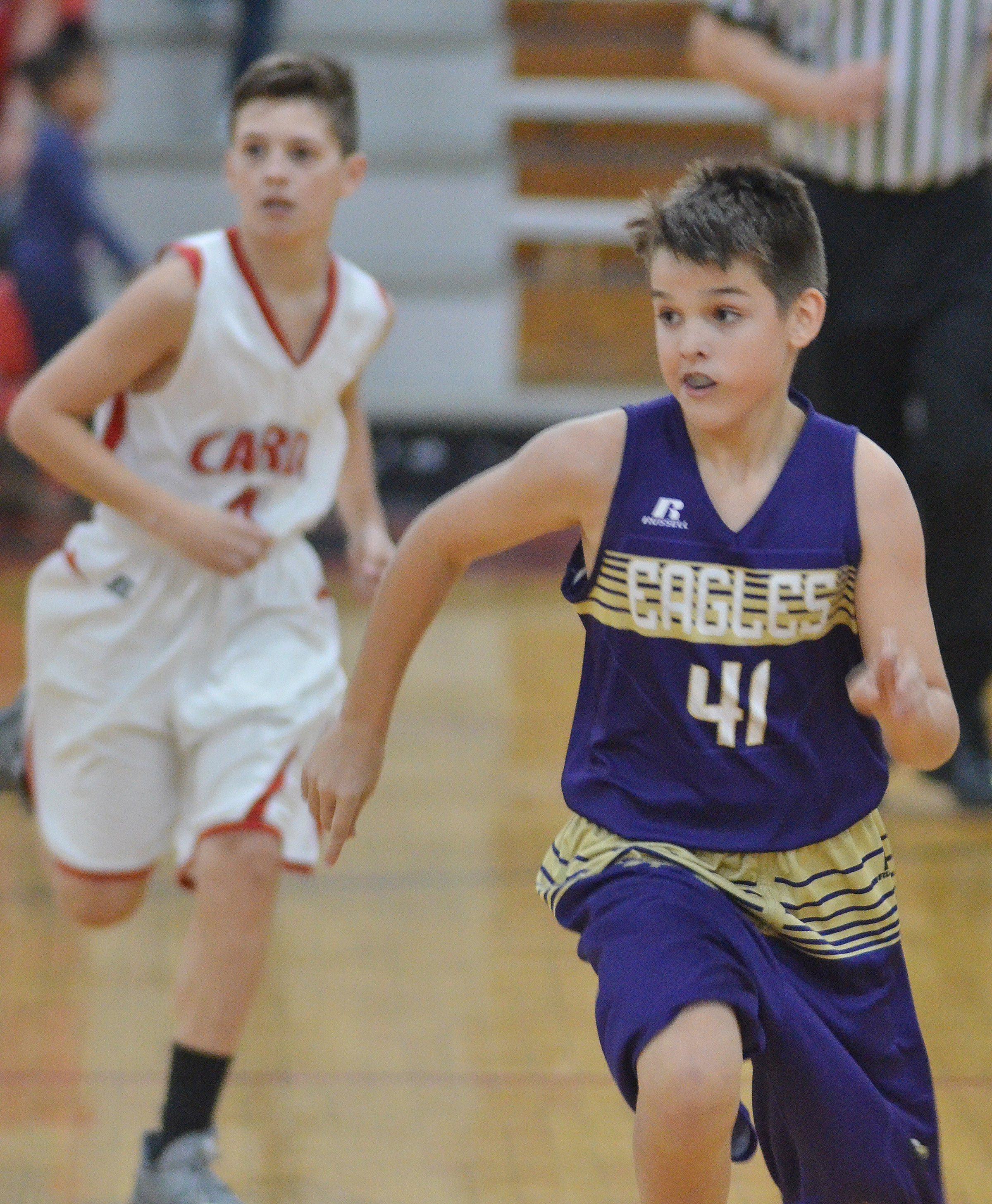 CMS sixth-grader Kaden Bloyd runs down the court.