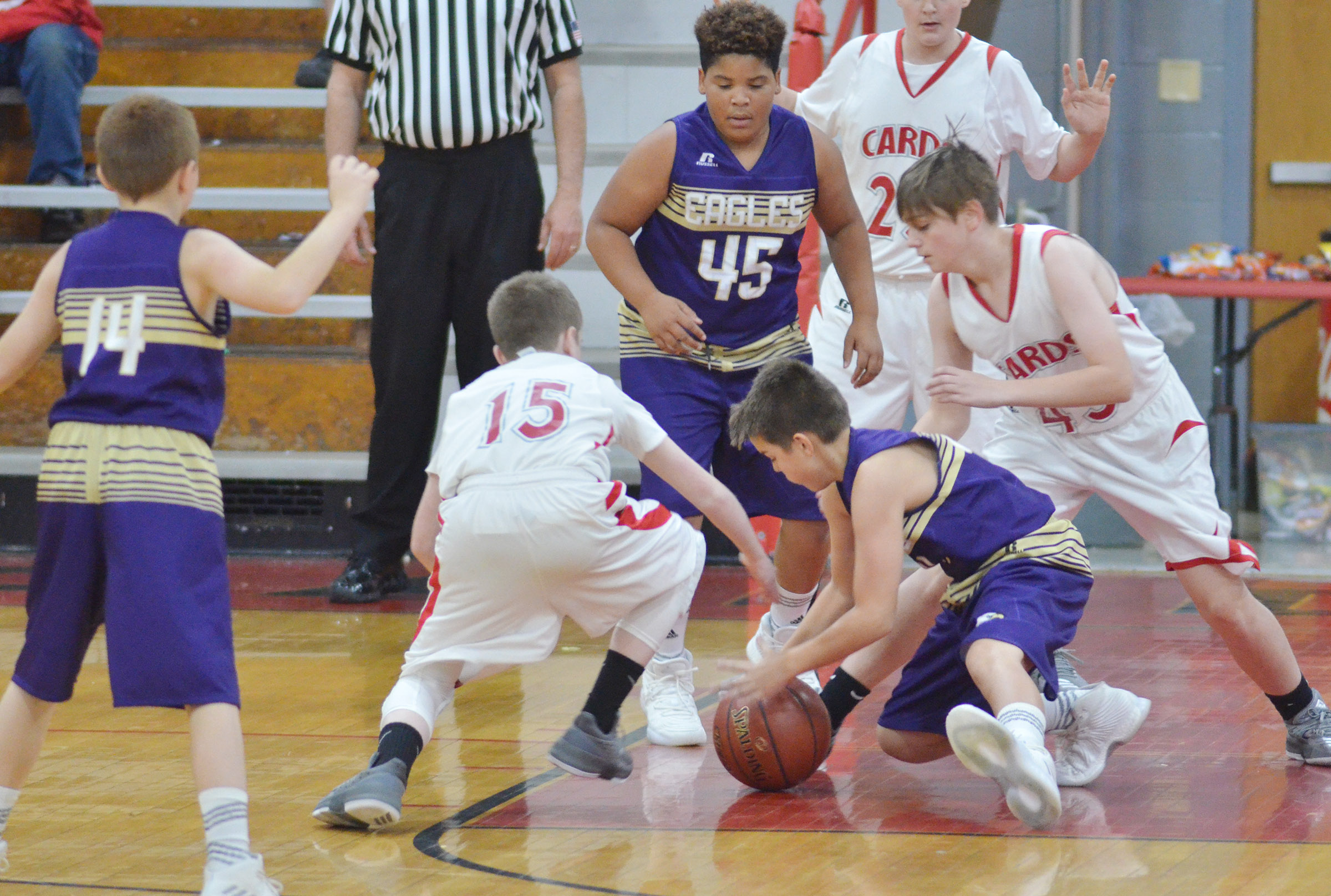 CMS sixth-graders Devin Kinser, standing, and Kaden Bloyd battles for the ball.