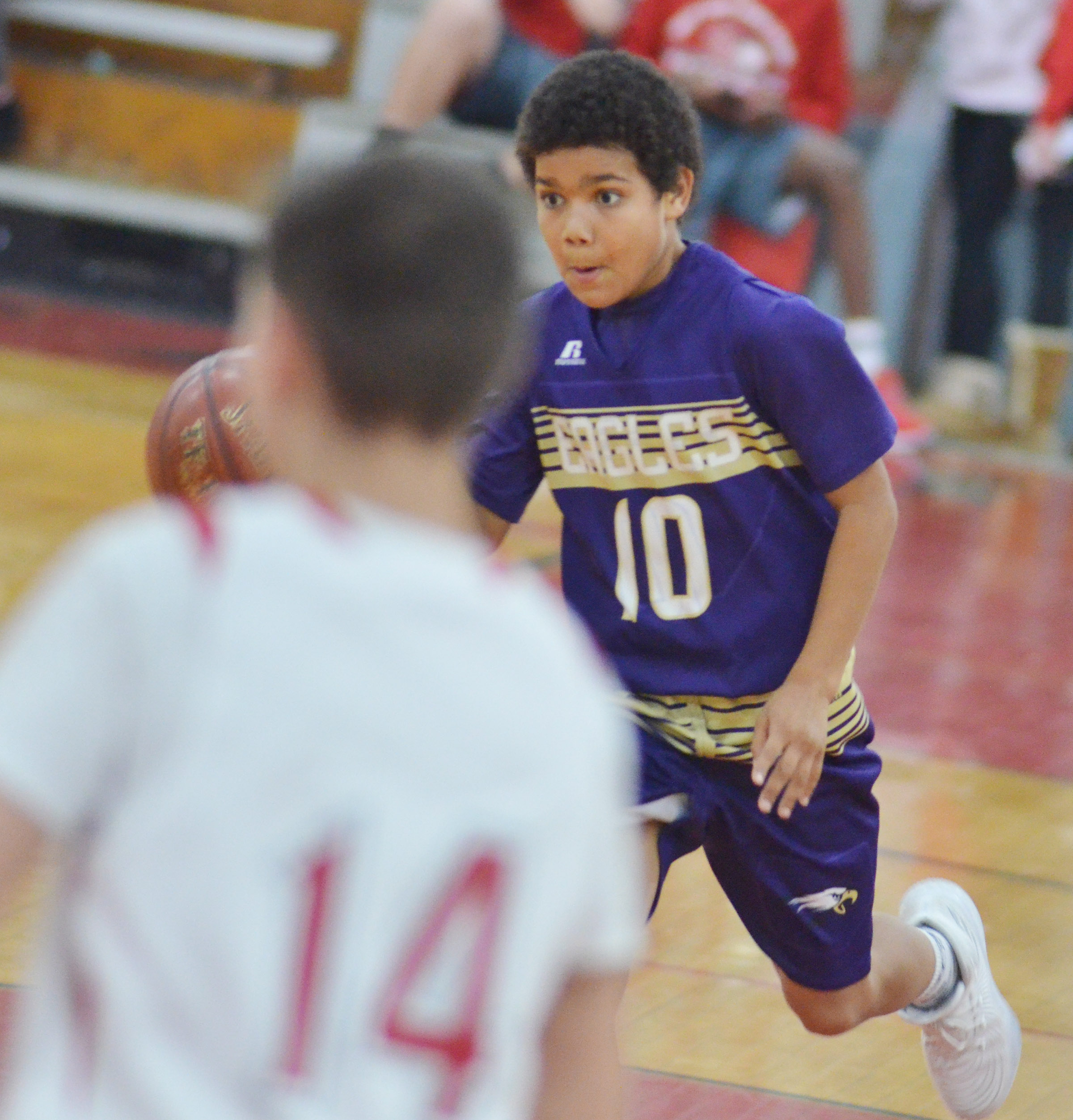 CMS sixth-grader Tashaun Hart dribbles to the hoop.