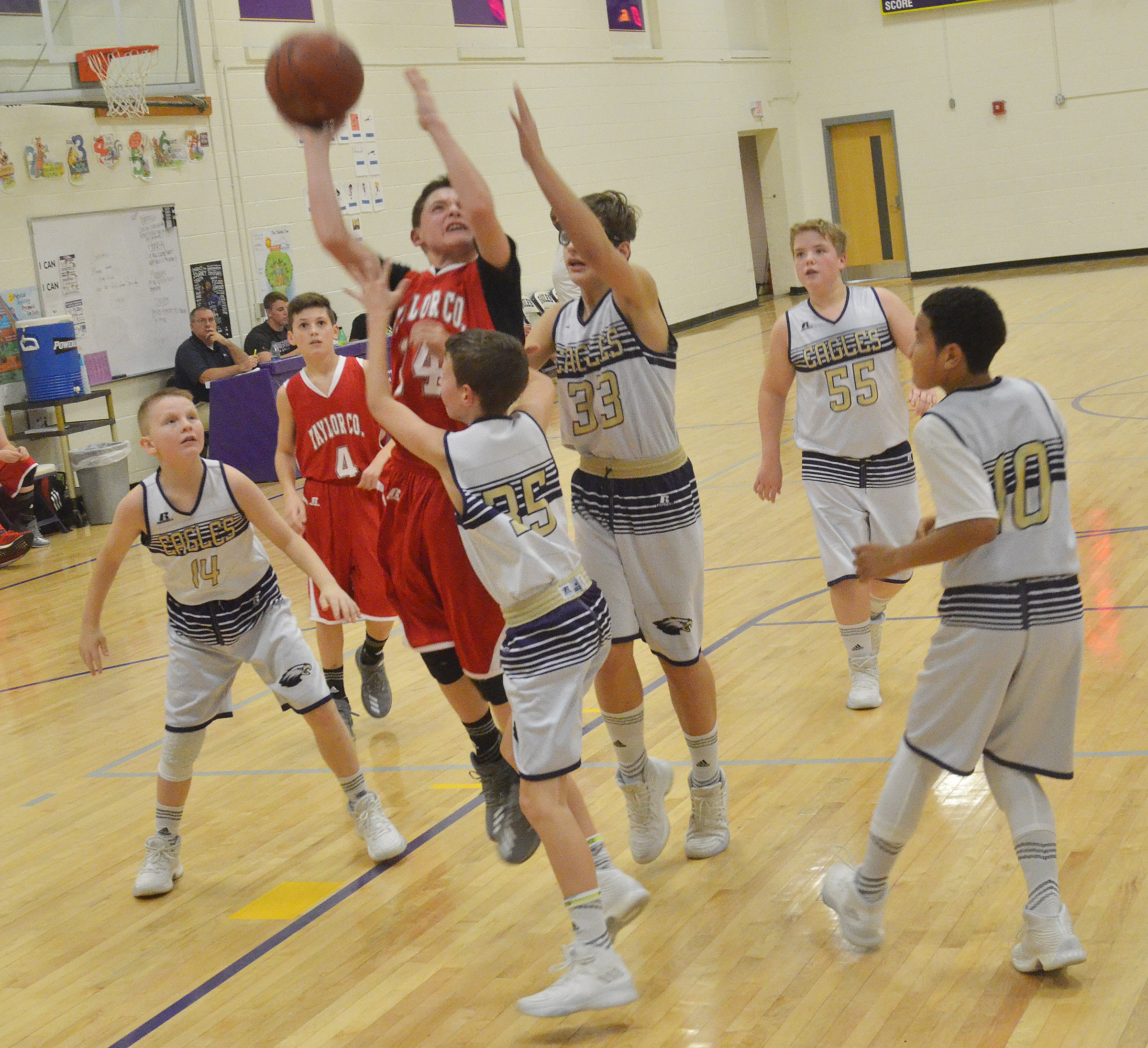 CMS boys' basketball players attempt to block a shot.