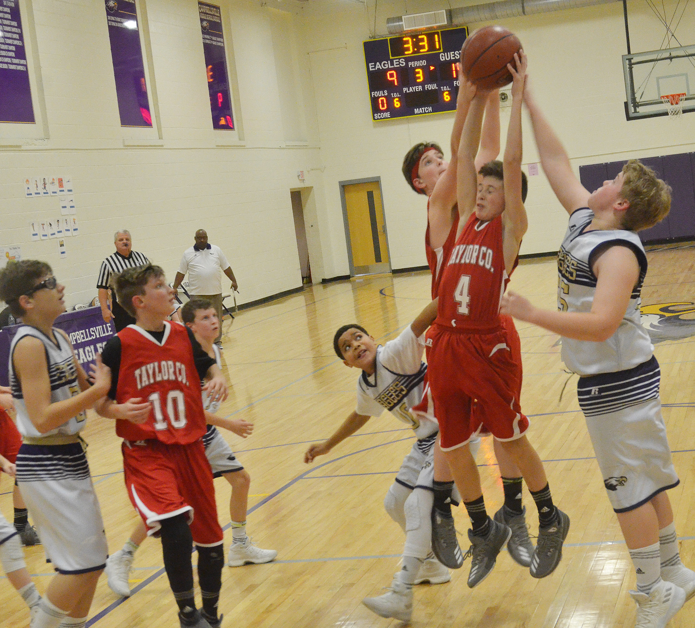 CMS sixth-grader Ryan Grubbs, at right, attempts to steal the ball.