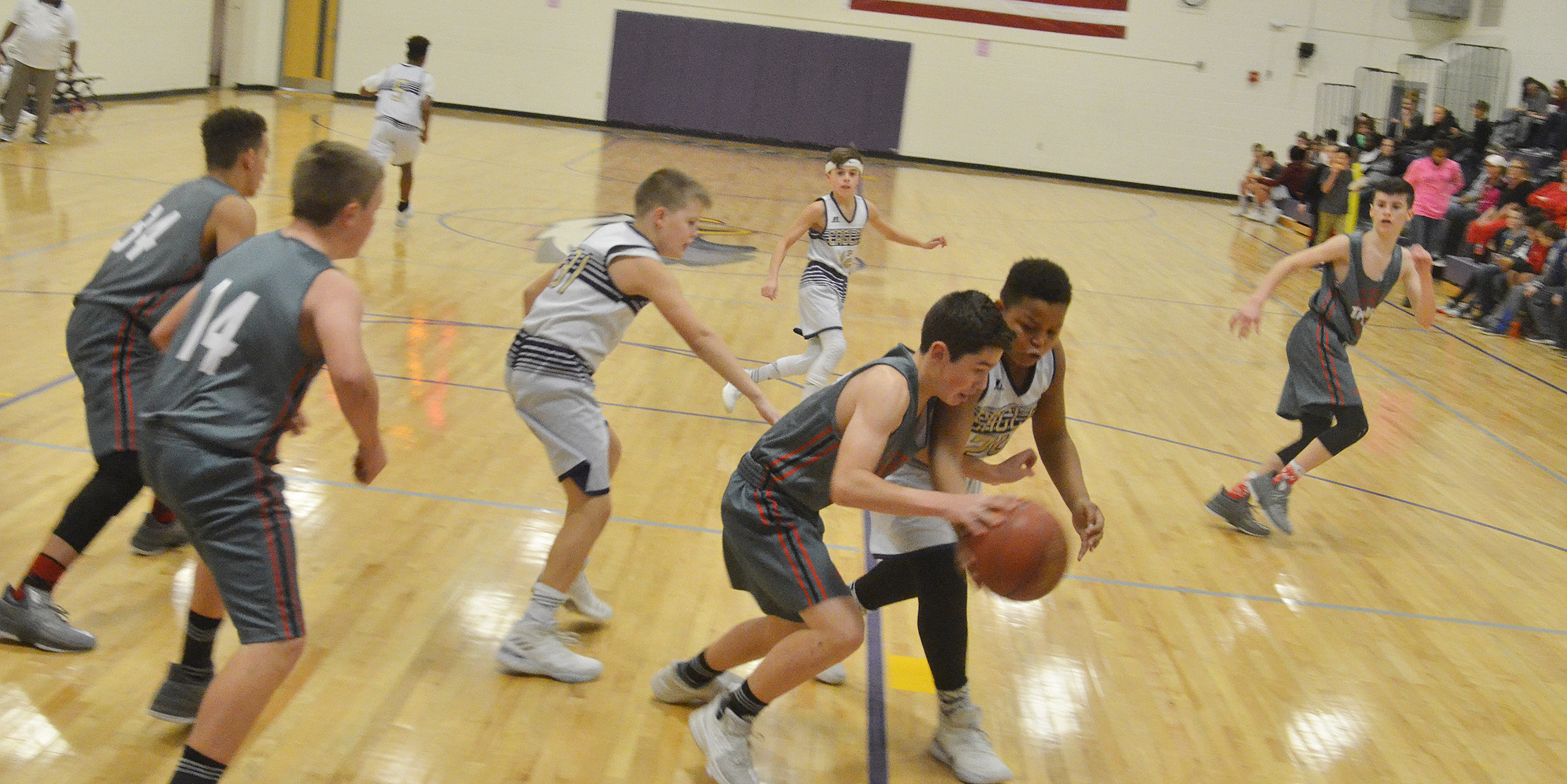 CMS seventh-grader Keondre Weathers attempts to steal.
