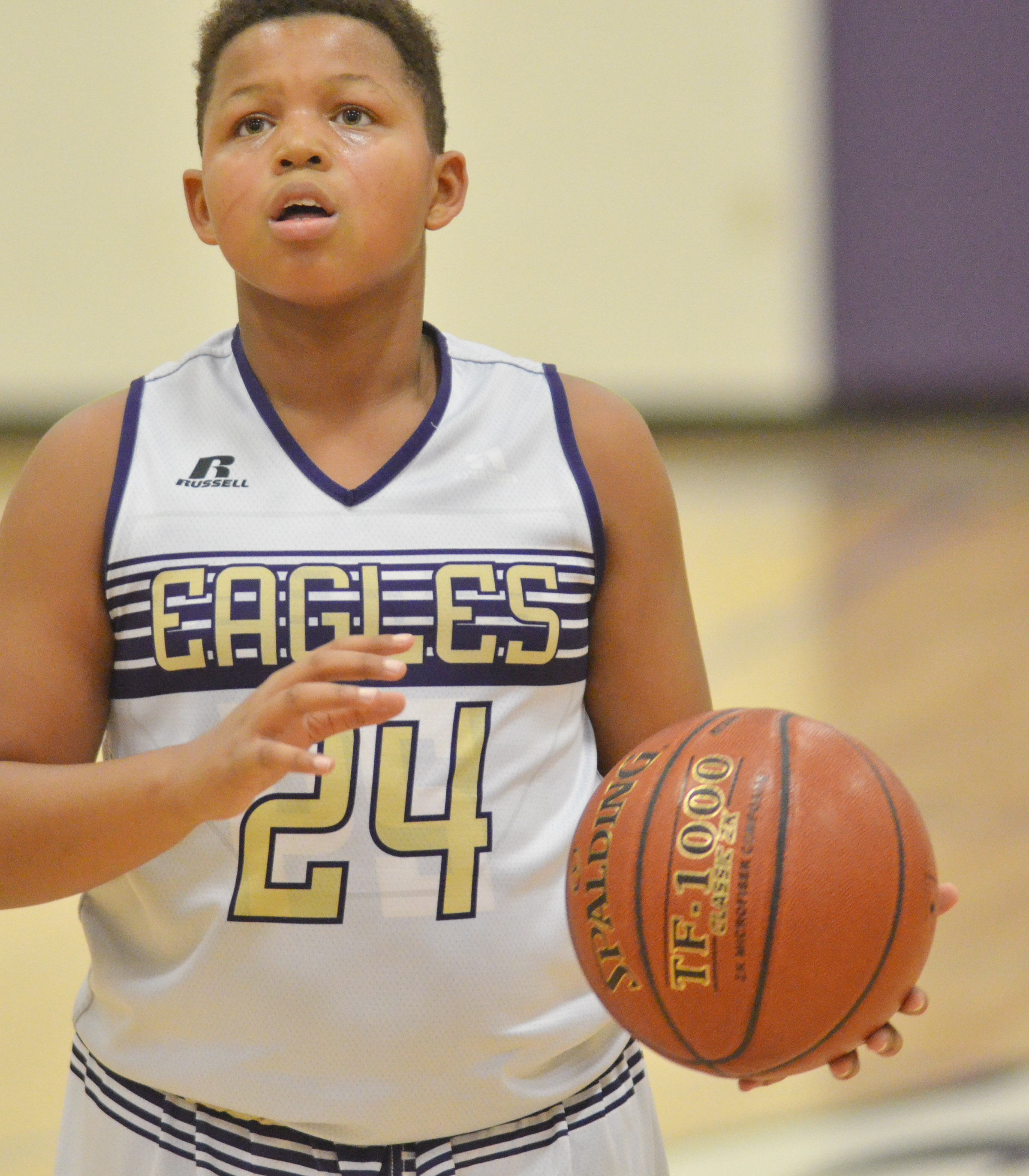 CMS seventh-grader Keondre Weathers shoots the ball.