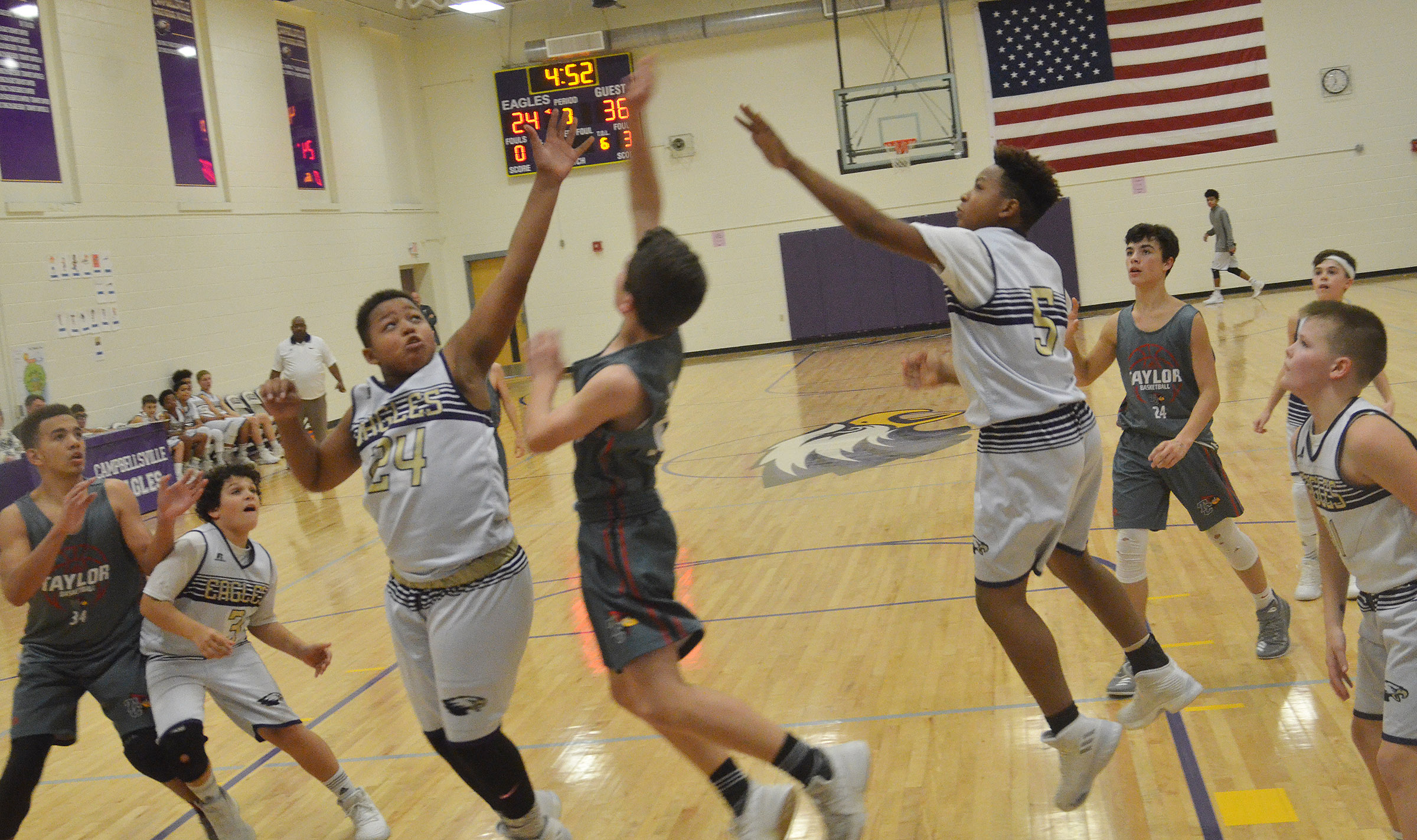 CMS seventh-graders Keondre Weathers, at left, and his twin brother Deondre Weathers jump to block a shot.