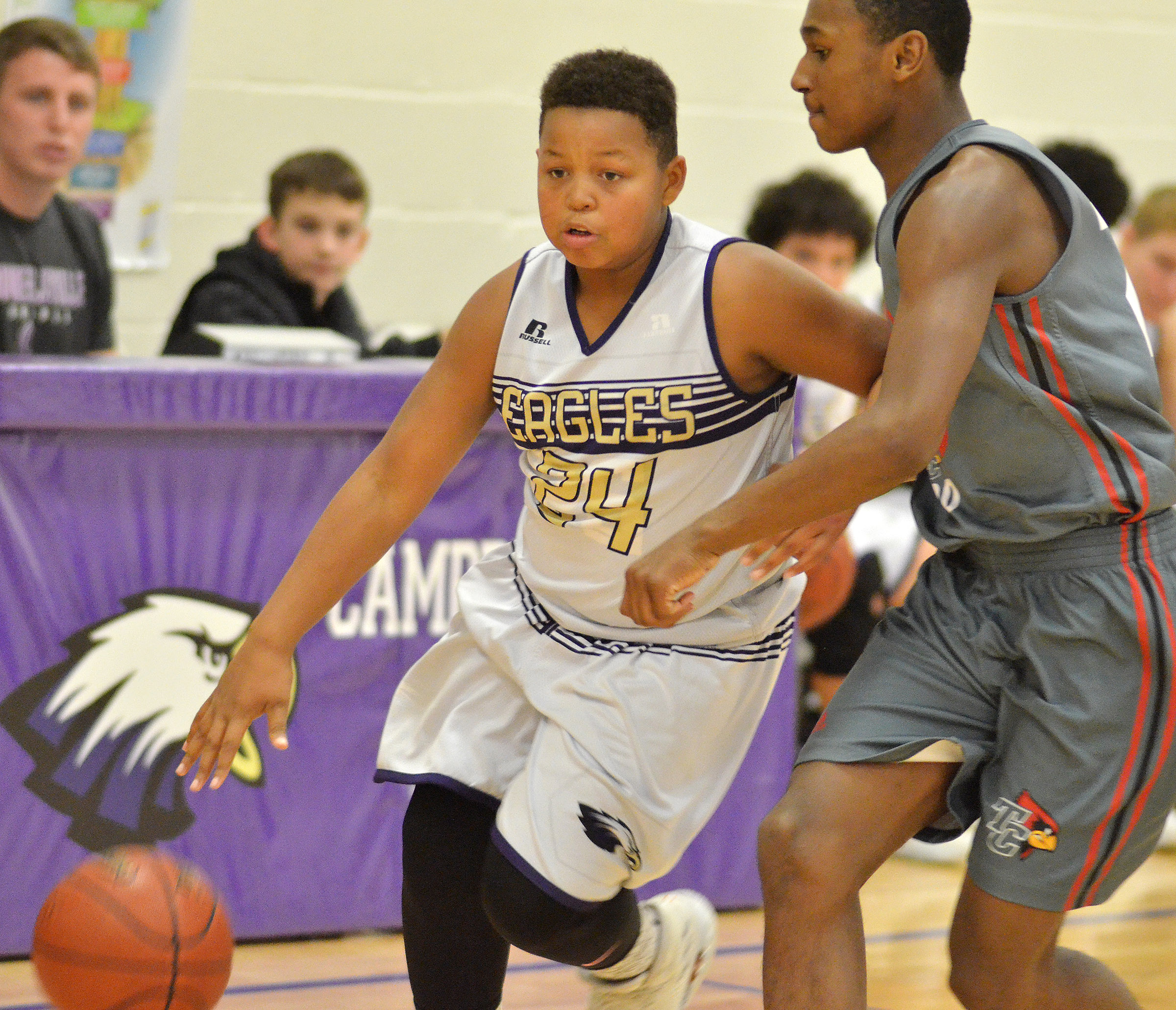 CMS seventh-grader Keondre Weathers dribbles to the basket.
