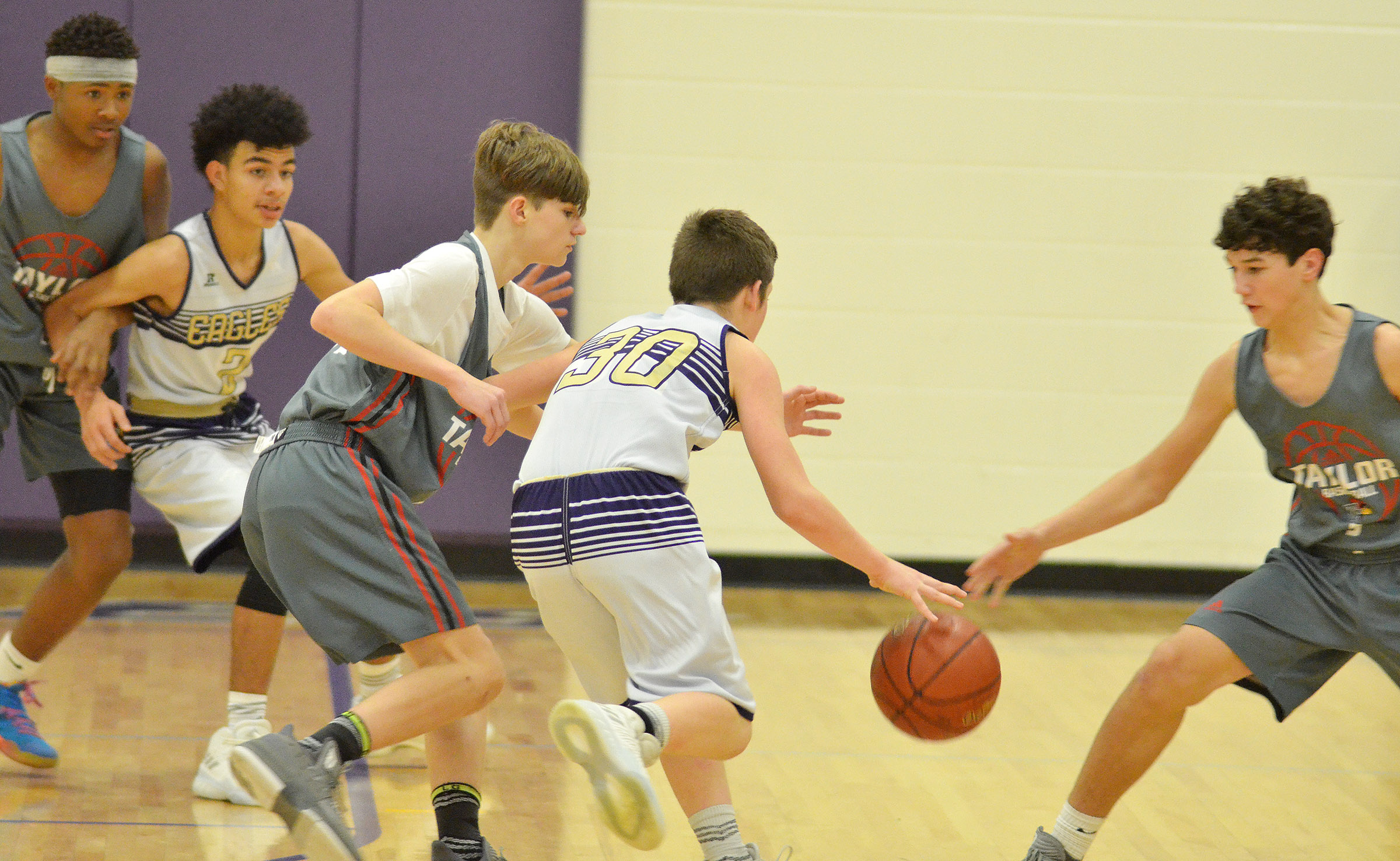 CMS eighth-grader Josh Lucas drives the ball as classmate Adrien Smith plays defense.