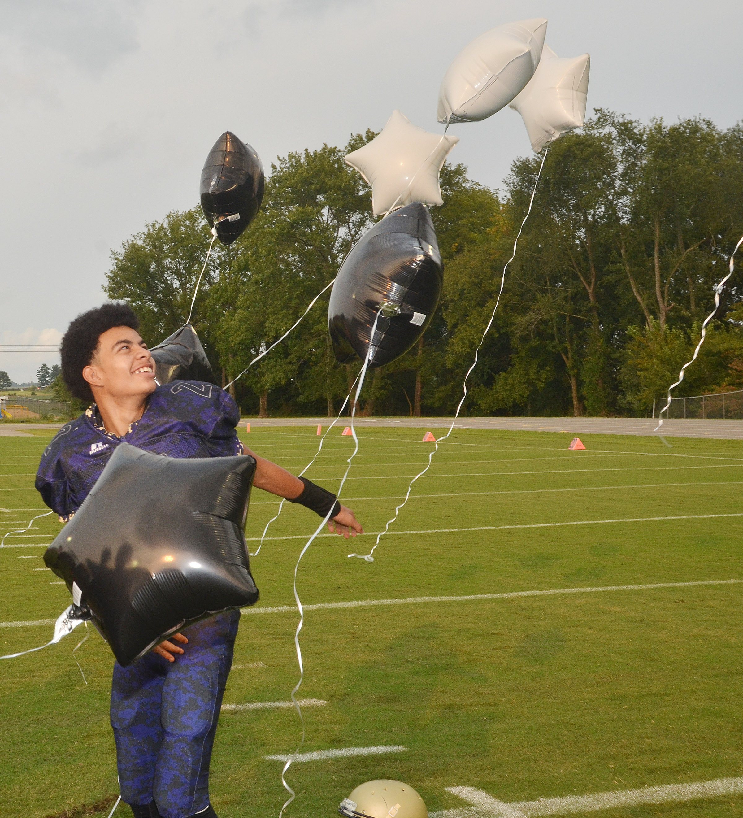 CMS eighth-grader Adrien Smith releases balloons in honor of his brother, the late Cameron Smith, who died in 2013.