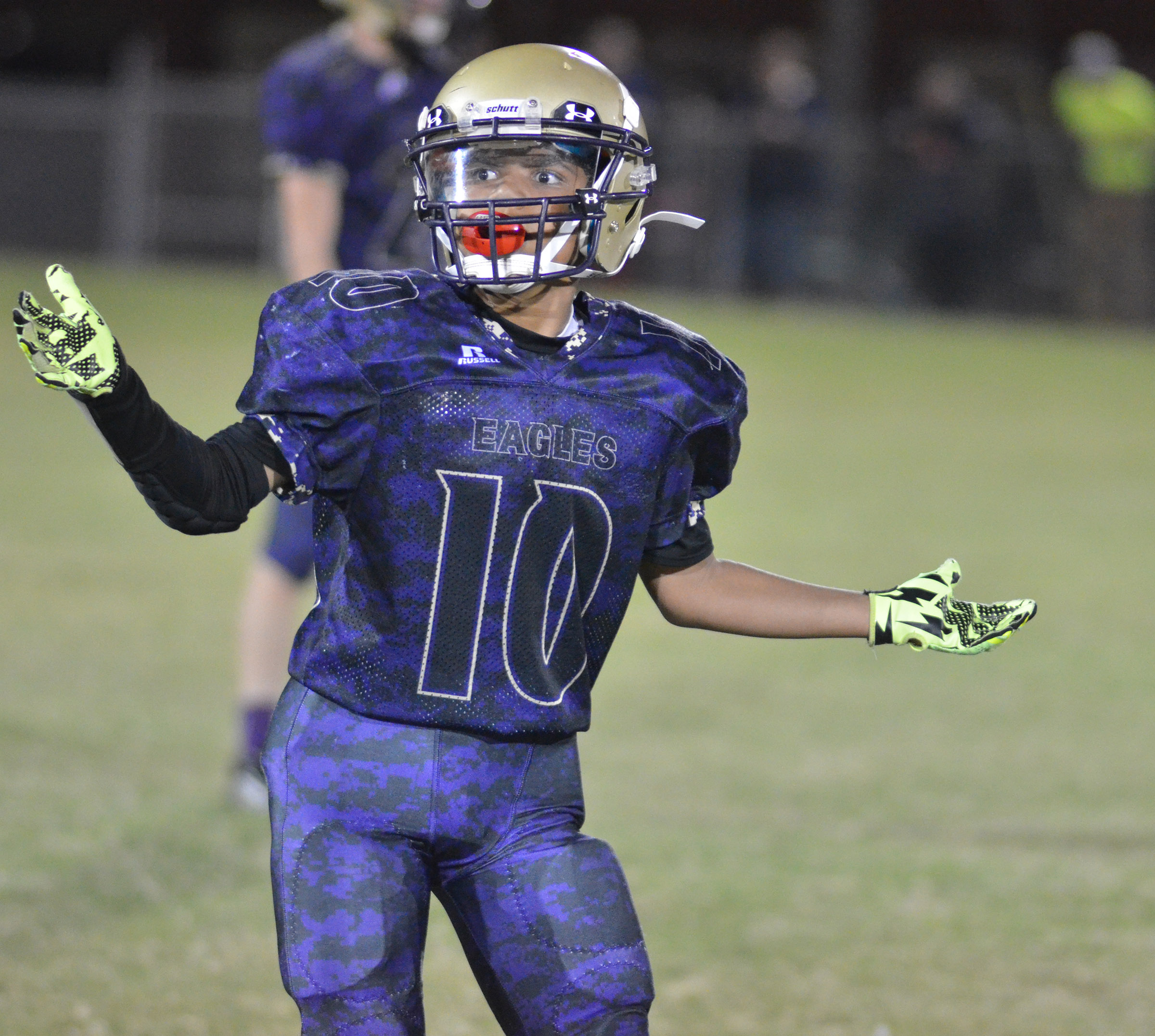 CMS sixth-grader Tashaun Hart looks to his coaches for the play.