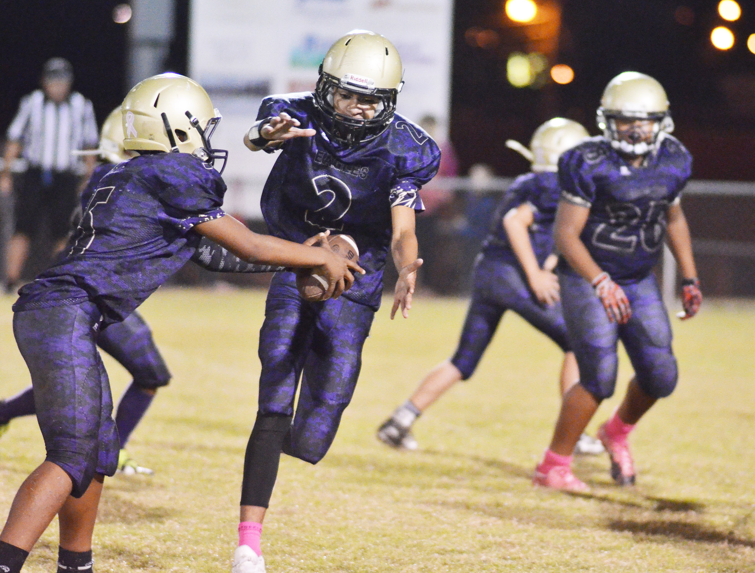 CMS seventh-grader Deondre Weathers passes the ball to eighth-grader Adrien Smith.
