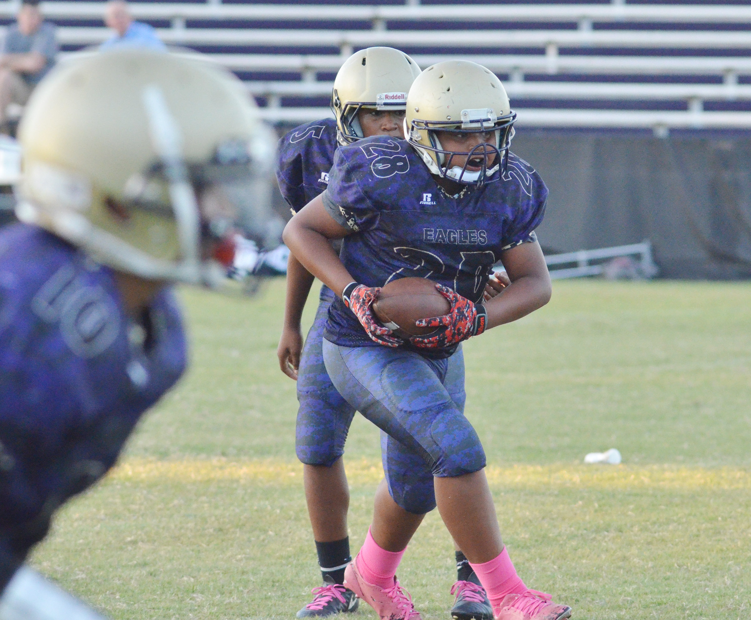 CMS seventh-grader Keondre Weathers gets the ball.