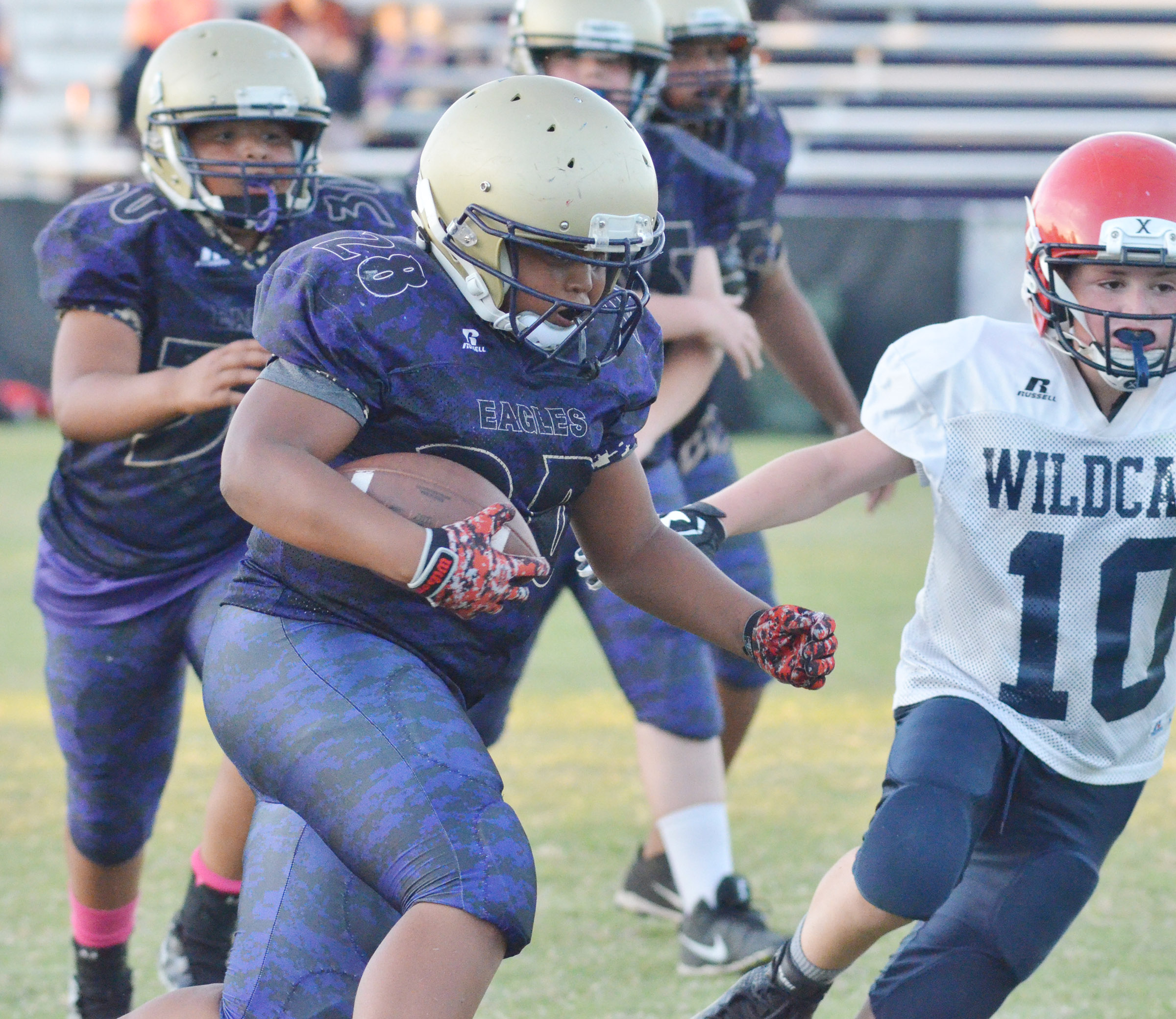 CMS seventh-grader Keondre Weathers runs the ball.