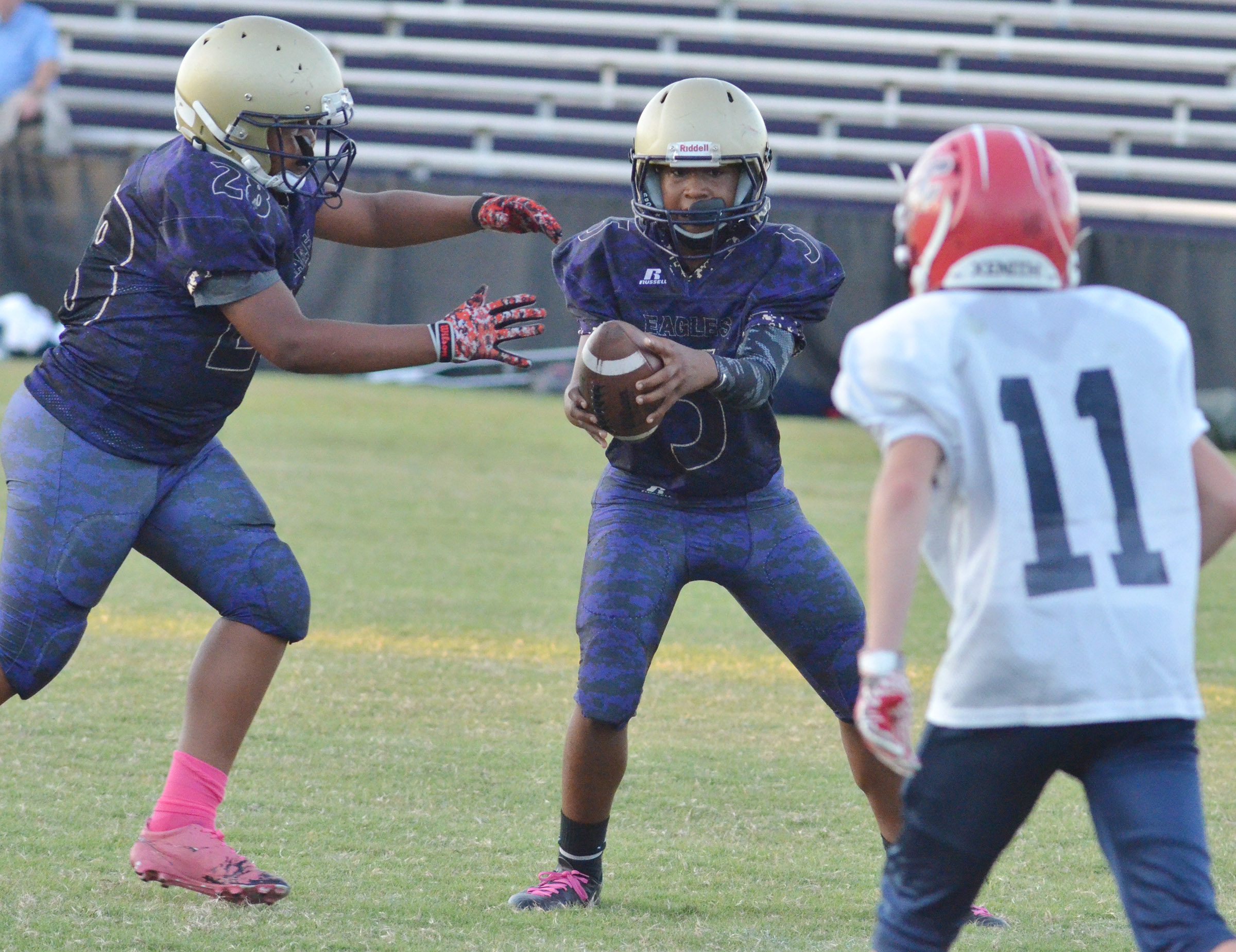 CMS seventh-grader Deondre Weathers passes the ball to his twin brother Keondre.