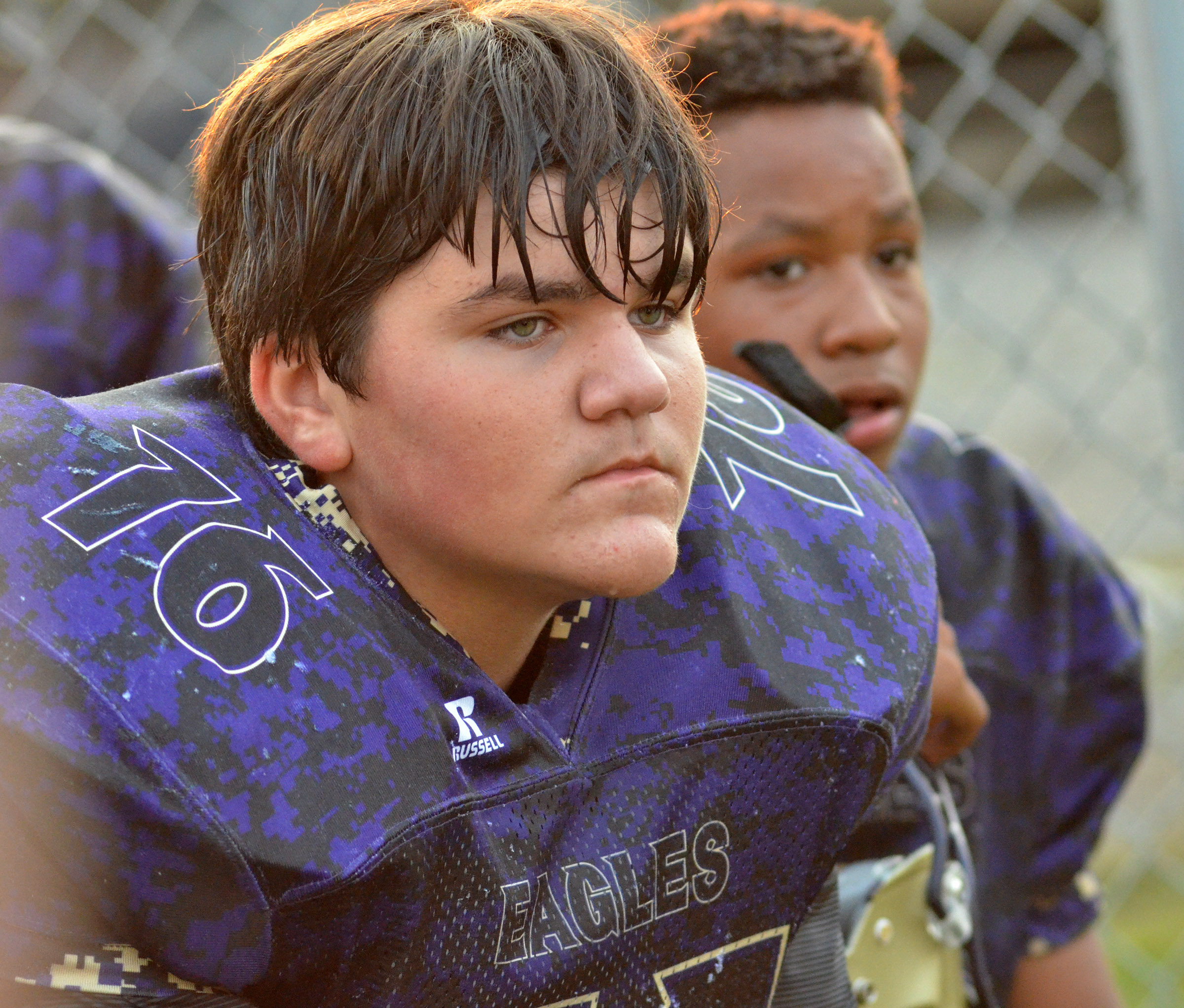 CMS eighth-grader Logan Rakes listens to his coaches at halftime.