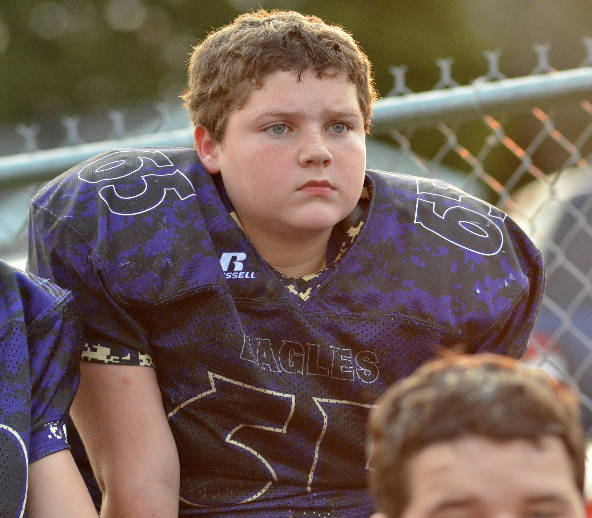 CMS sixth-grader Johnathon Foster listens to his coaches at halftime.